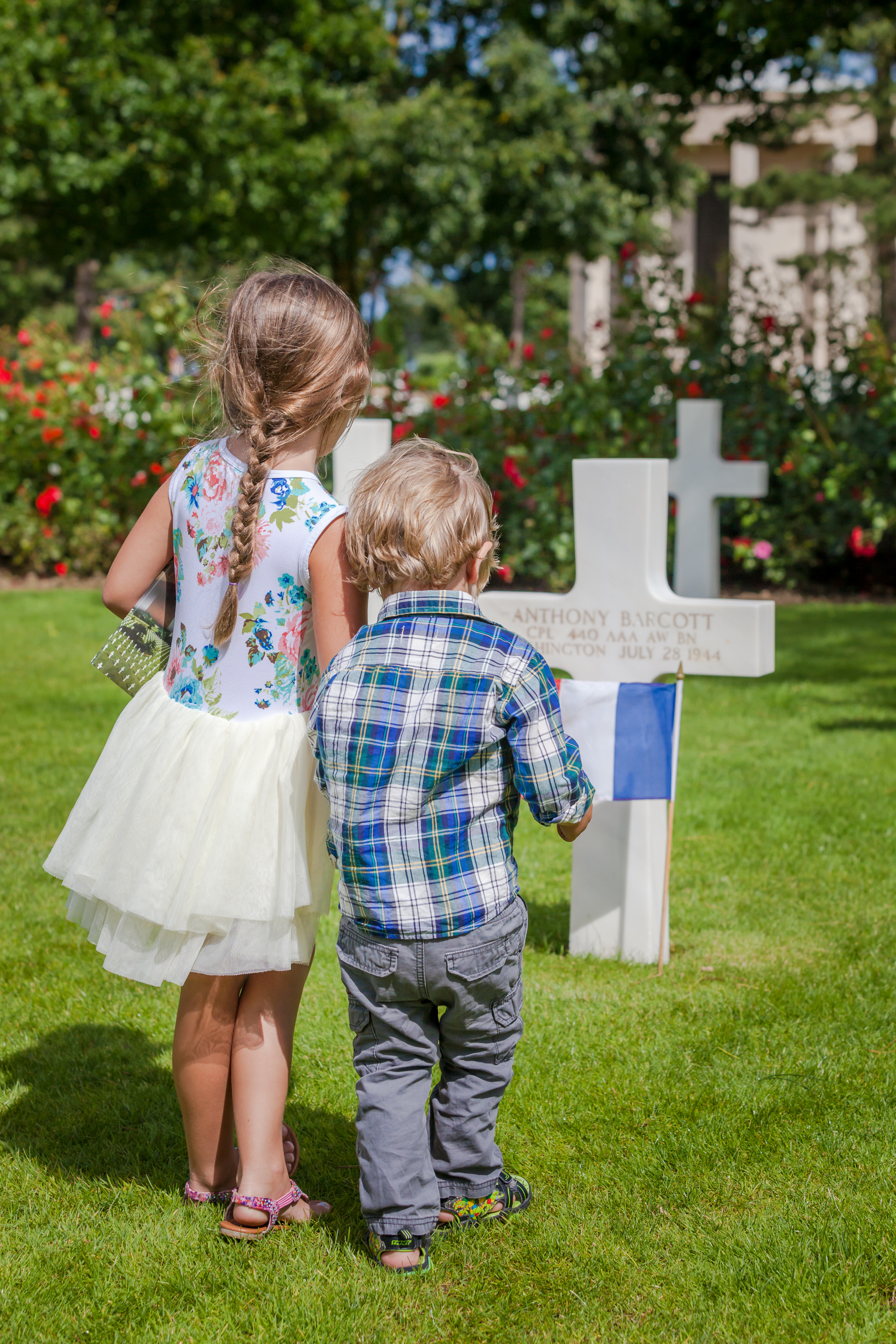 The author's children, looking at the grave of his great-uncle