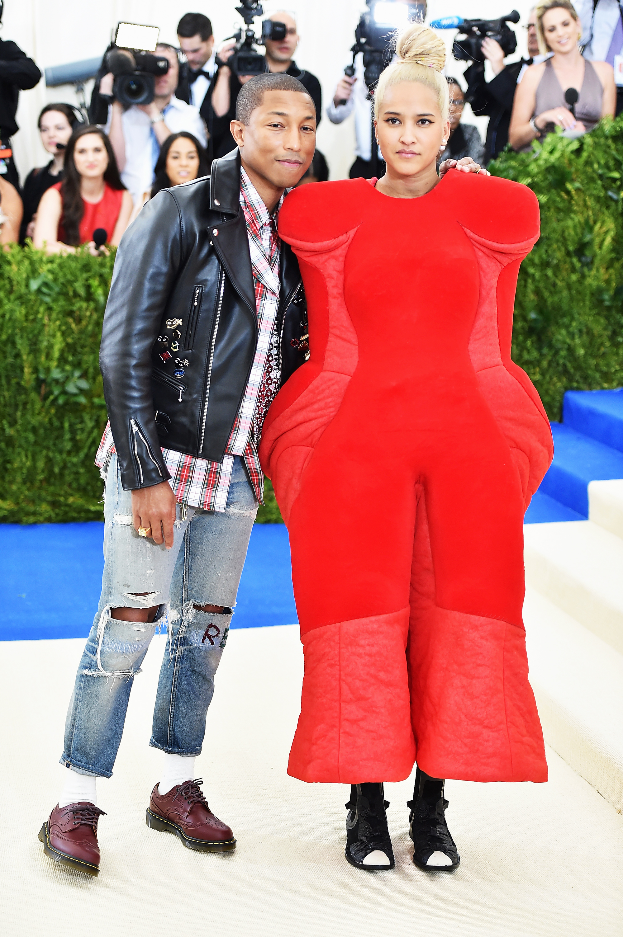 Pharrell Williams and Helen Lasichanh attend The Metropolitan Museum of Art's Costume Institute benefit gala celebrating the opening of the Rei Kawakubo/Comme des Garçons: Art of the In-Between exhibition in New York City, on May 1, 2017.
