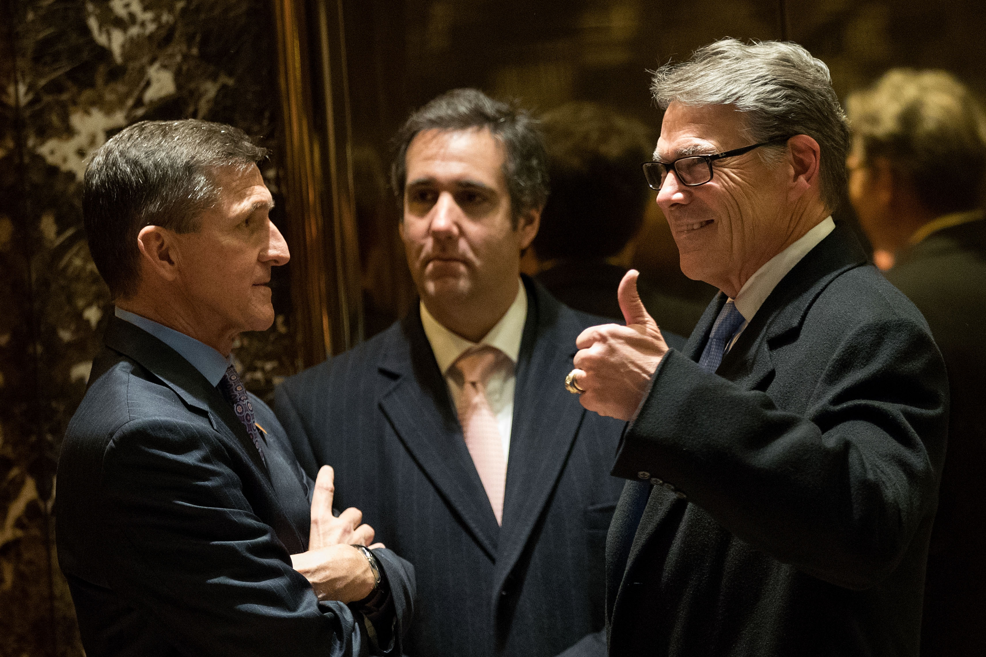Retired Lt. Gen. Michael Flynn, Michael Cohen, executive vice president of the Trump Organization and special counsel to Donald Trump, and former Texas Governor Rick Perry at Trump Tower, Dec. 12, 2016 in New York City.