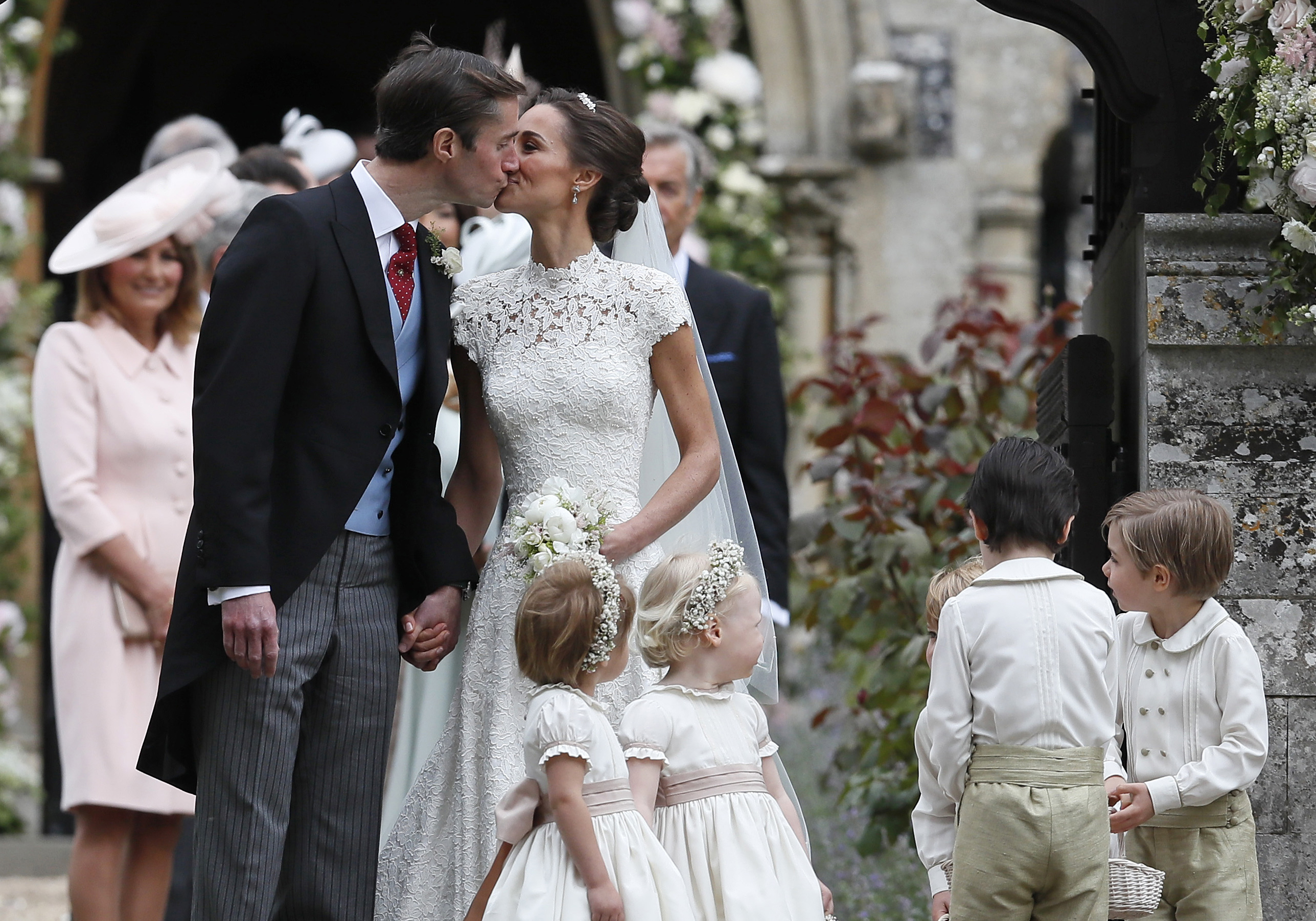 Pippa Middleton and James Matthews kiss after their wedding at St Mark's Church on May 20, 2017 in Englefield, England.