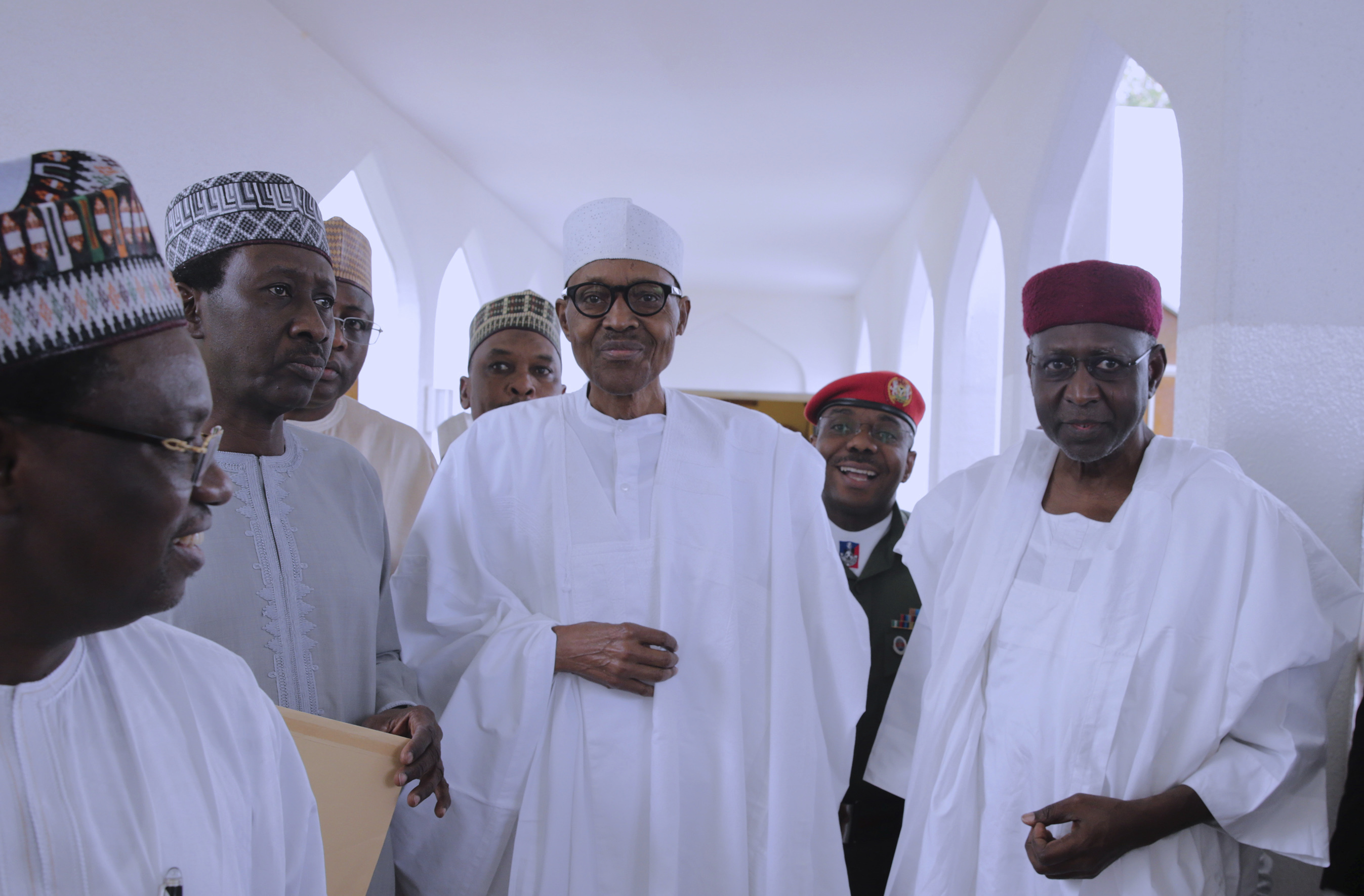 Nigeria's President Muhammadu Buhari with government officials after Friday prayers at the presidential palace in Abuja, Nigeria on May 5, 2017. Nigeria's 74-year old president has emerged to attend Friday prayers after missing a number of public engagements and three straight weekly cabinet meetings because of poor health.