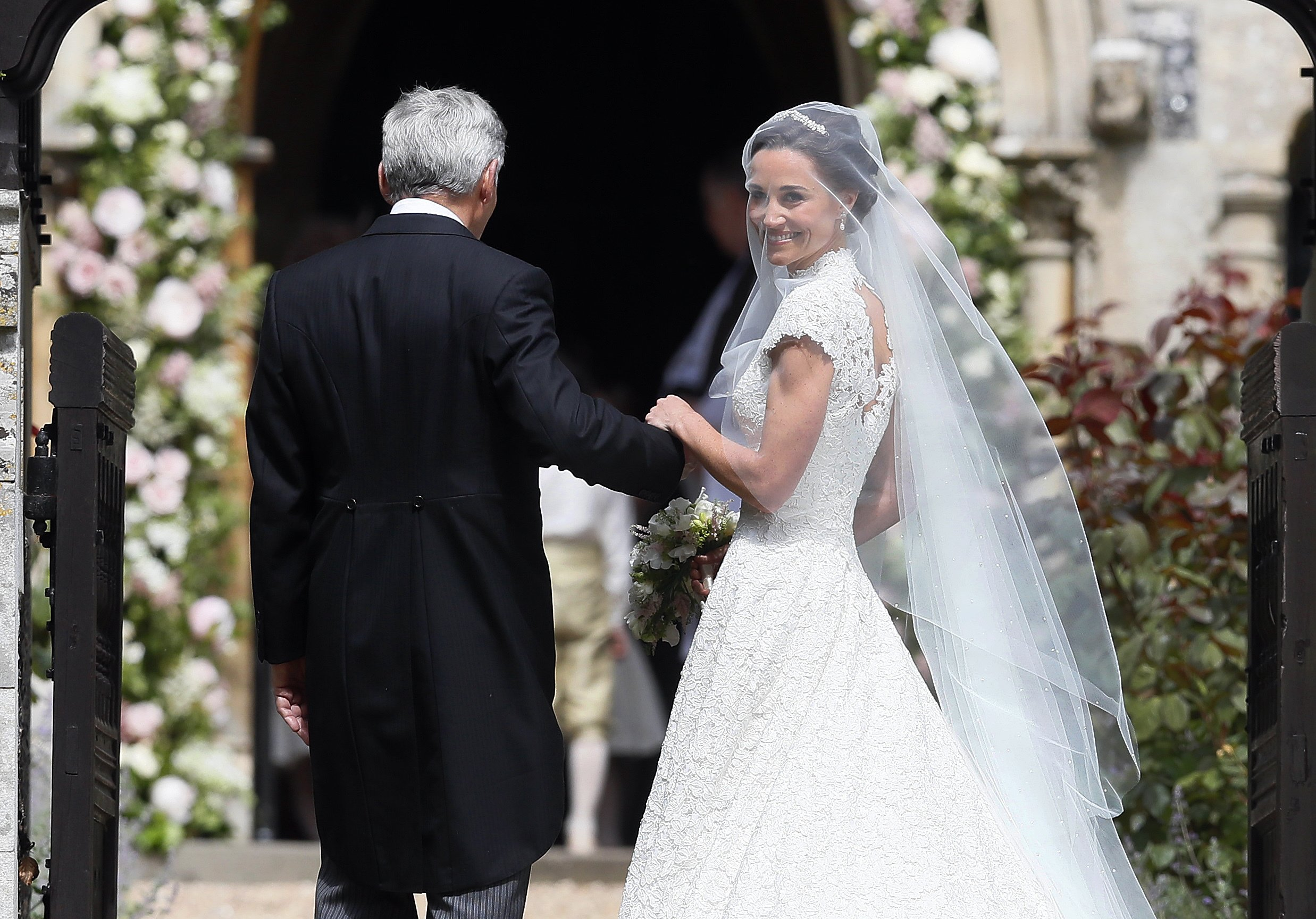 Pippa Middleton arrives with her father Michael Middleton for her wedding to James Matthews at St Mark's Church in Englefield, England, on May 20, 2017.