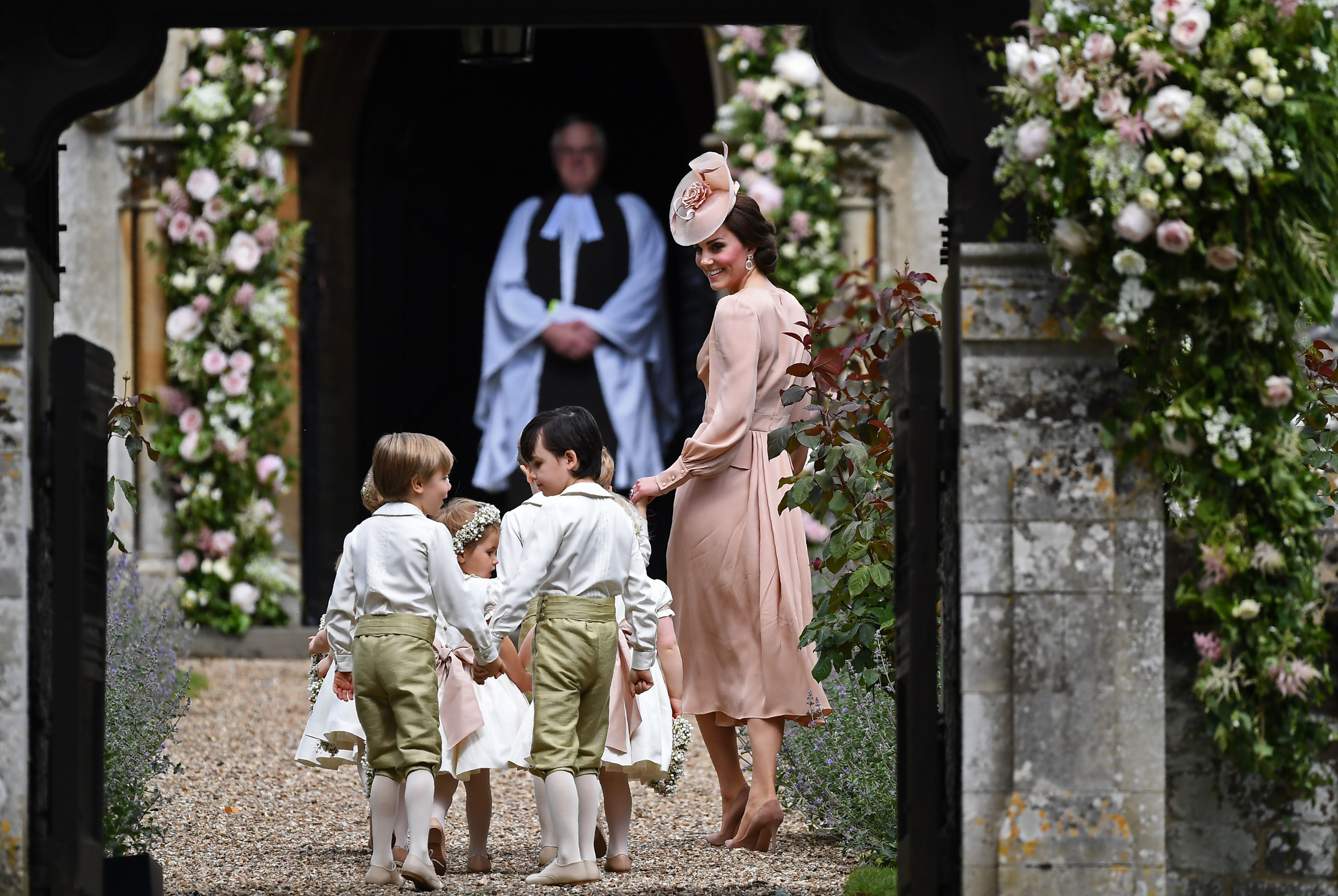 Catherine, Duchess of Cambridge walks with the bridesmaids and pageboys as they arrive as they arrive for her sister Pippa Middleton's wedding to James Matthews at St Mark's Church on May 20, 2017 in Englefield Green, England.