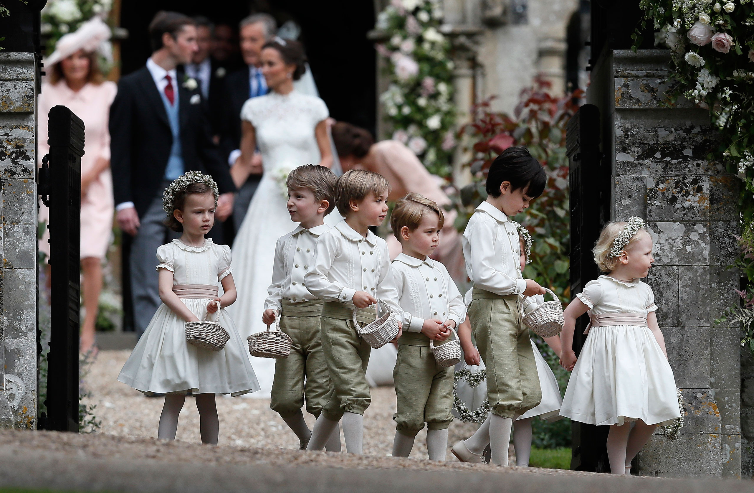 Prince George, fourth left, stands with other flower boys and girls after the wedding of Pippa Middleton and James Matthews at St Mark's Church on May 20, 2017 in Englefield, England.
