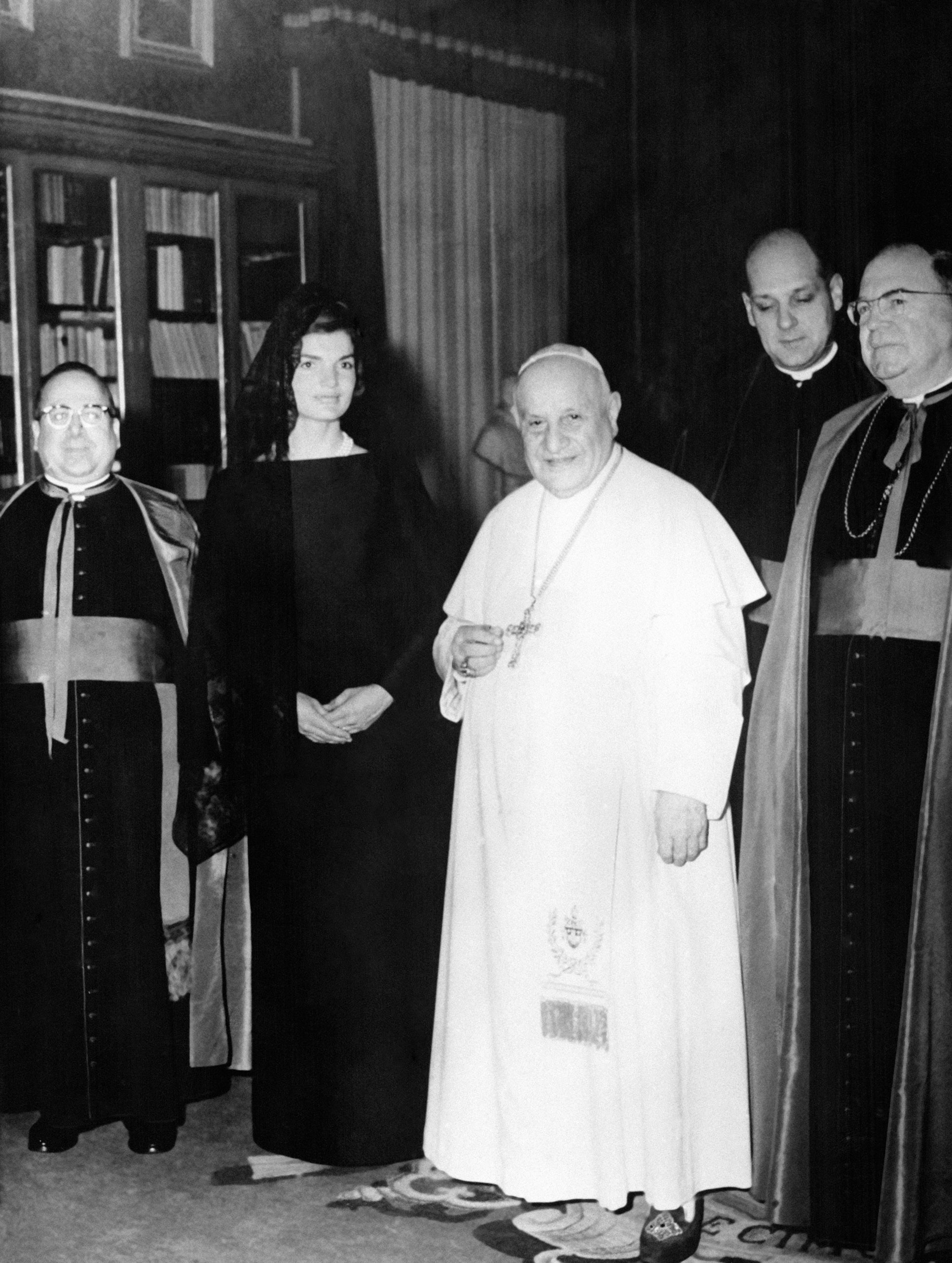 Jacqueline Kennedy stands next to Pope John XXIII during an audience in the Pontiff's private library in the Vatican, Italy, March 11, 1962.