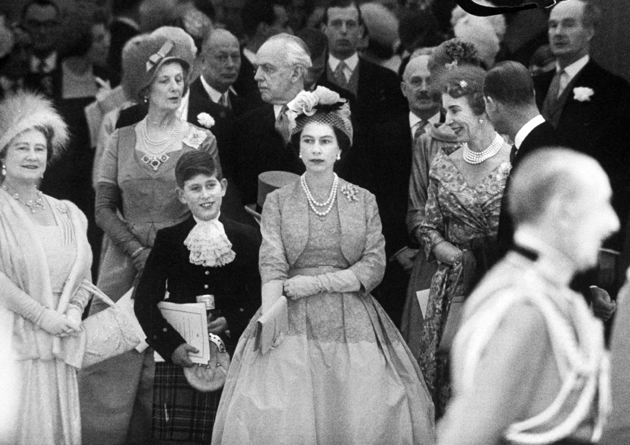 Prince Charles (2L) and Elizabeth II at Princess Margaret's wedding.  1960.