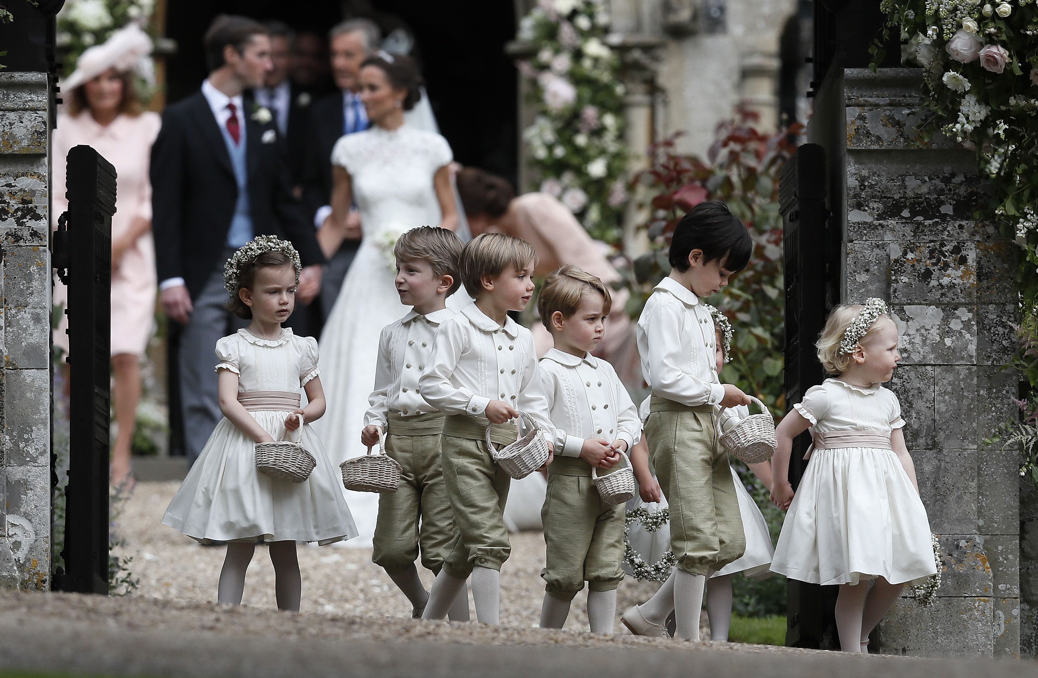Prince George, fourth left, stands with other flower boys and girls after the wedding of Pippa Middleton and James Matthews at St Mark's Church onMay 20, 2017 in Englefield, England.