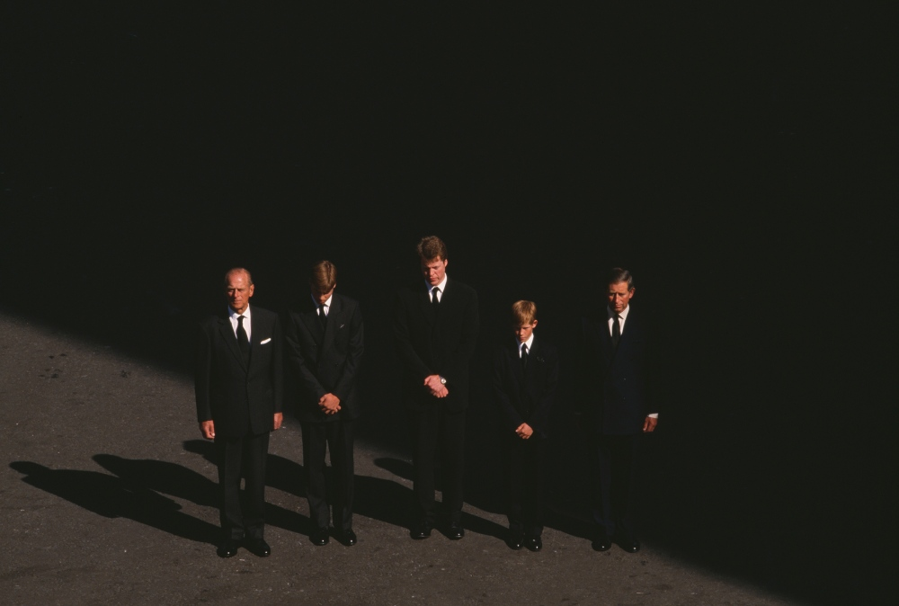 Prince Philip stands with Prince Charles, Prince Harry, and Prince William, Earl Spencer at the funeral of Princess Diana, on Sept. 6, 1997.