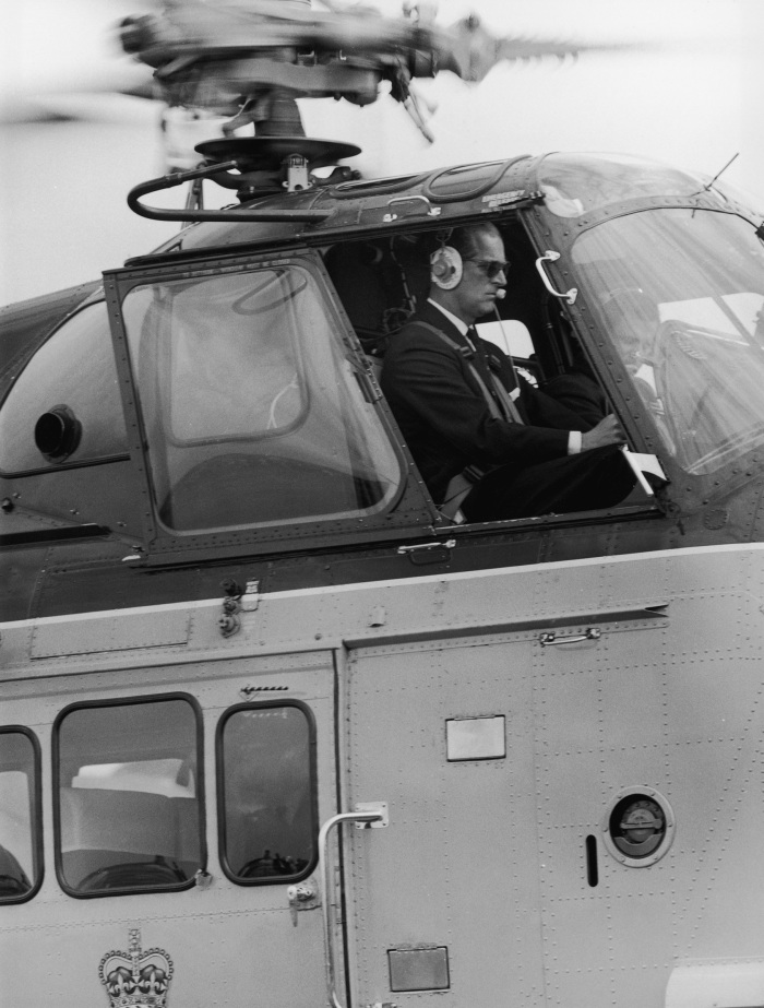 Prince Philip at the controls of the royal helicopter, July 28, 1965.
