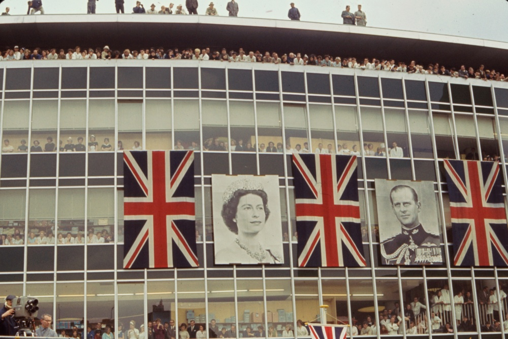 Crowds peer out windows and balconies to catch a glimpse of Queen Elizabeth II and Prince Philip, Bonn, Germany, May 1965.