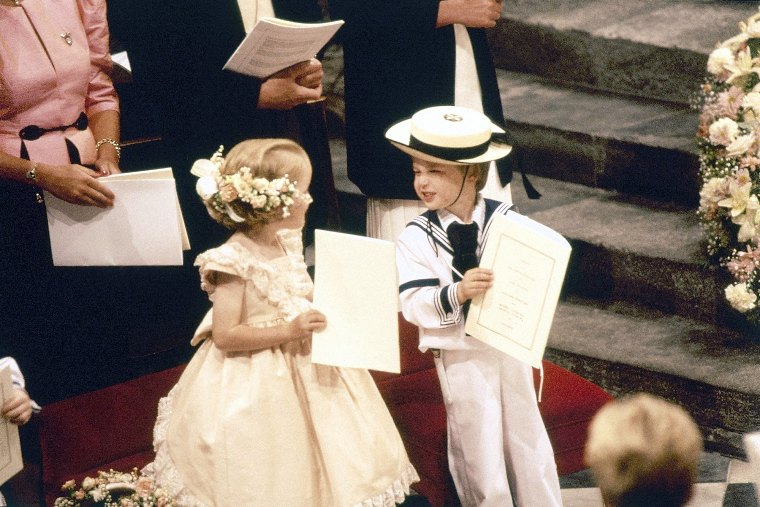 Four-year-old page Prince William of Wales exchanges glances with bridesmaid Laura Fellowes, 6, during the marriage of Prince Andrew and Sarah Ferguson at Westminster Abbey in London, July 23, 1986.