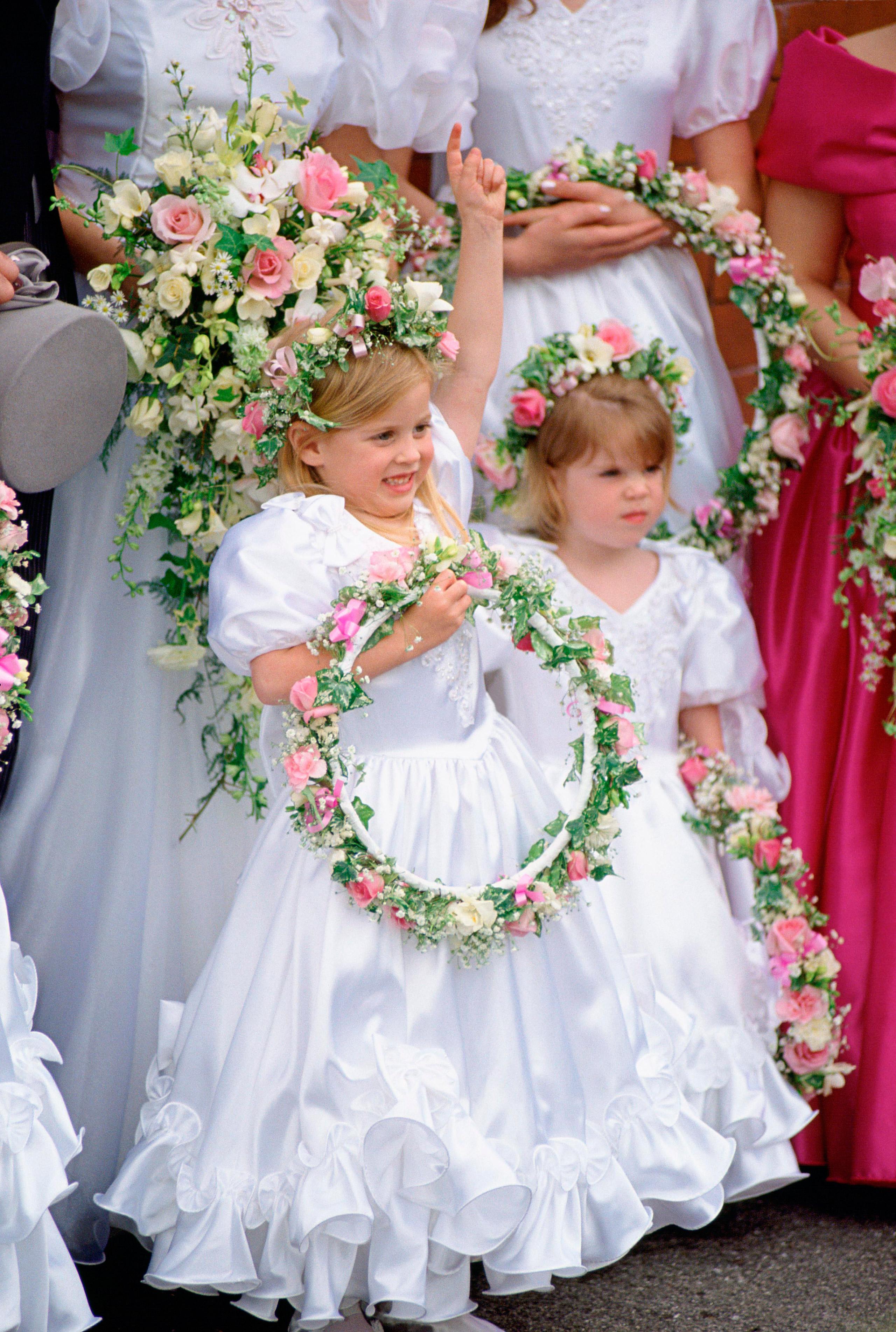 Princess Beatrice and Princess Eugenie as bridesmaids at Alison Wardley wedding. 1993.