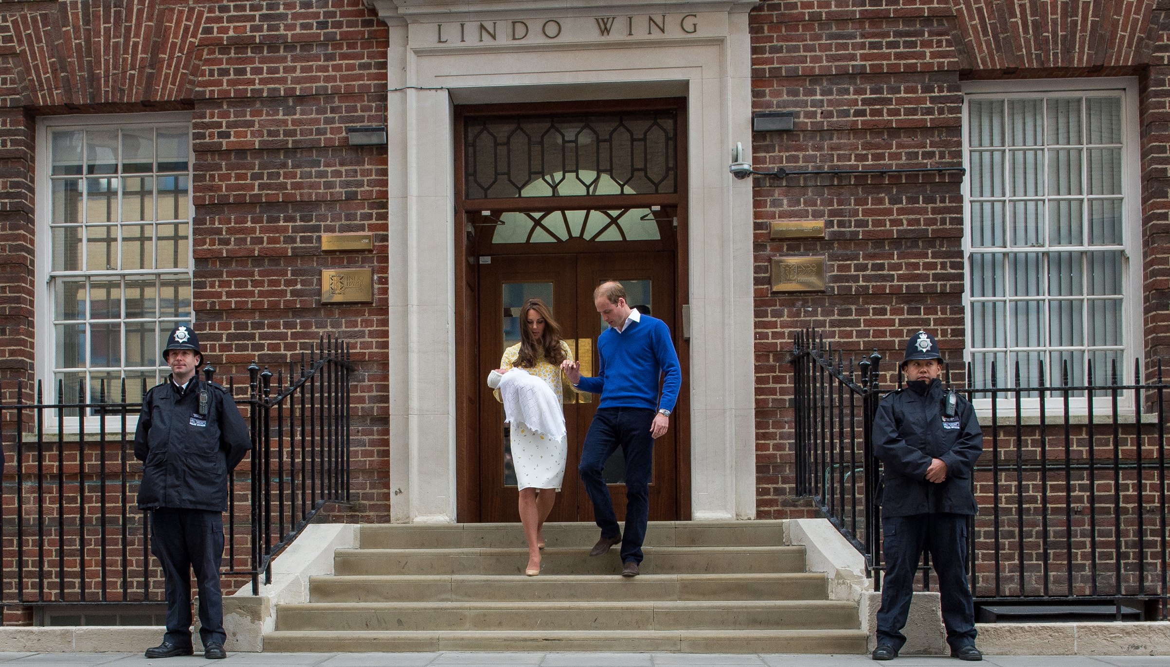 Prince William, Duke of Cambridge, and Catherine, Duchess of Cambridge, depart the Lindo Wing with their newborn baby daughter at St. Mary's Hospital in London on May 2, 2015.