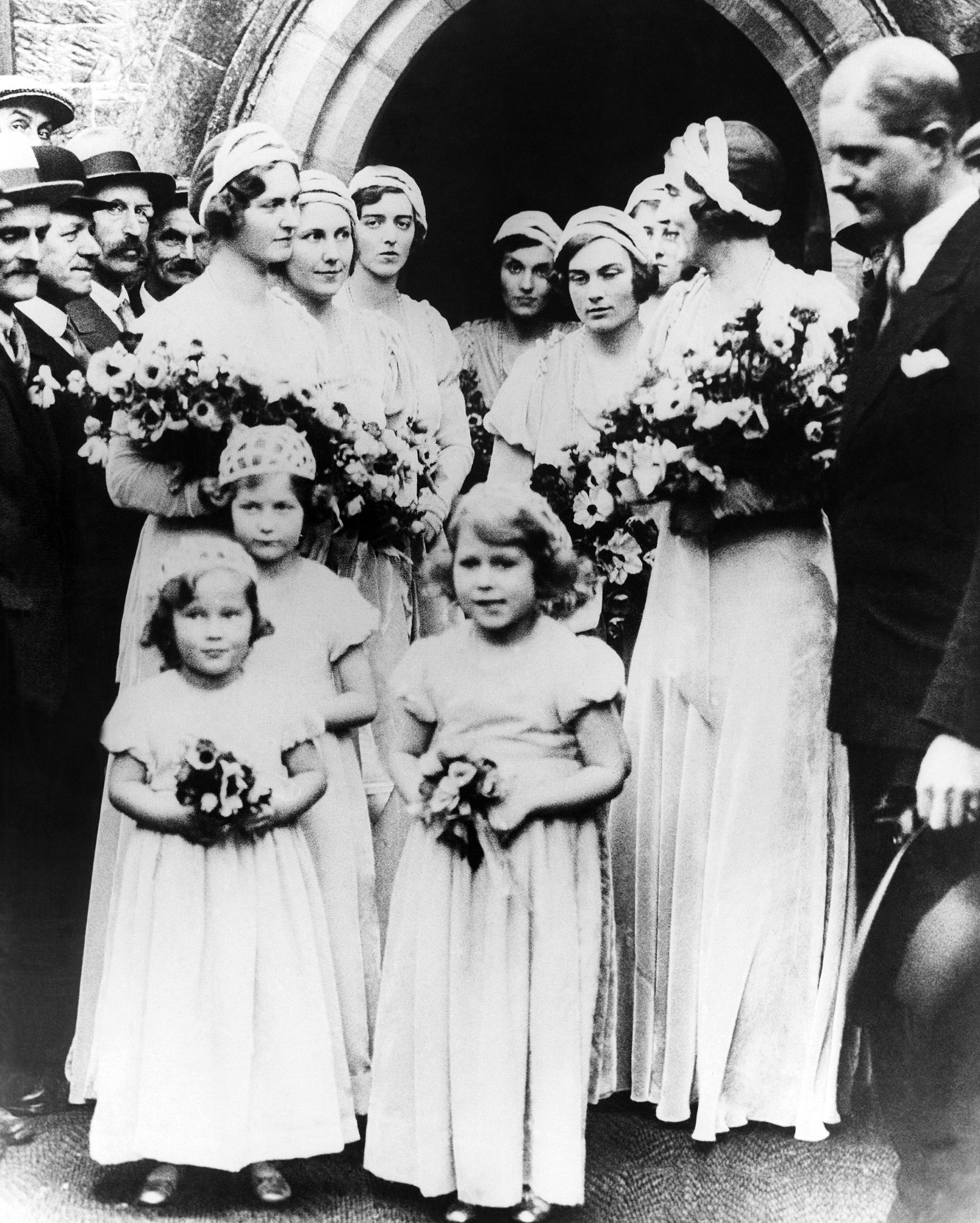 Bridal attendants Jennifer Bevan, Princess Elizabeth and Princess Ingrid of Sweden at Lady May Cambridge and Captain Henry Abel Smith's wedding on Oct. 24, 1931.