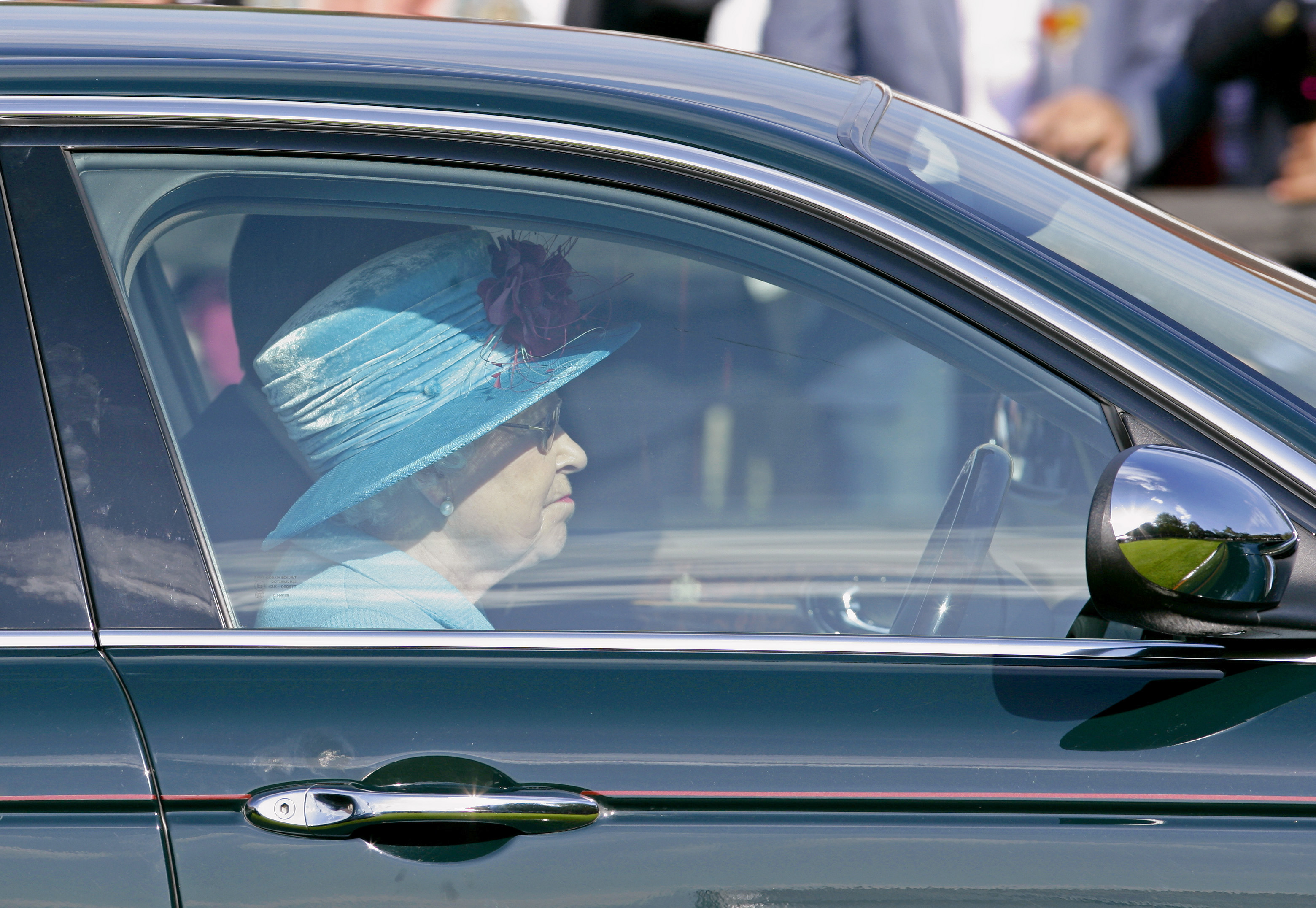 EGHAM, UNITED KINGDOM - JUNE 13: (EMBARGOED FOR PUBLICATION IN UK NEWSPAPERS UNTIL 48 HOURS AFTER CREATE DATE AND TIME) HM Queen Elizabeth II drives her Jaguar car as she leaves after watching the the final of the Harcourt Developments Queen's Cup polo tournament at Guards Polo Club on June 13, 2010 in Egham, England. (Photo by Indigo/Getty Images)