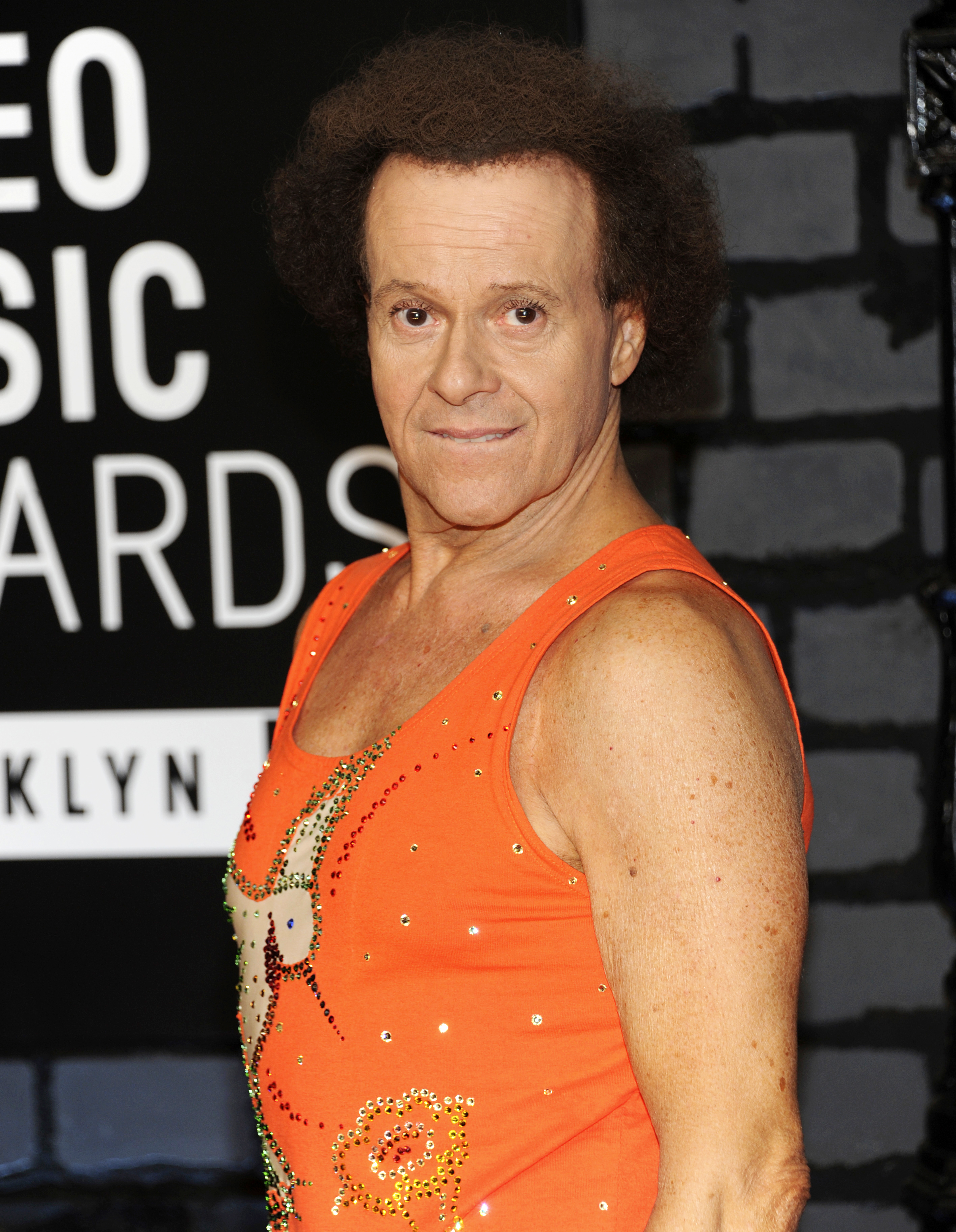 In this Aug. 25, 2013 file photo, Richard Simmons arrives at the MTV Video Music Awards in the Brooklyn borough of New York.