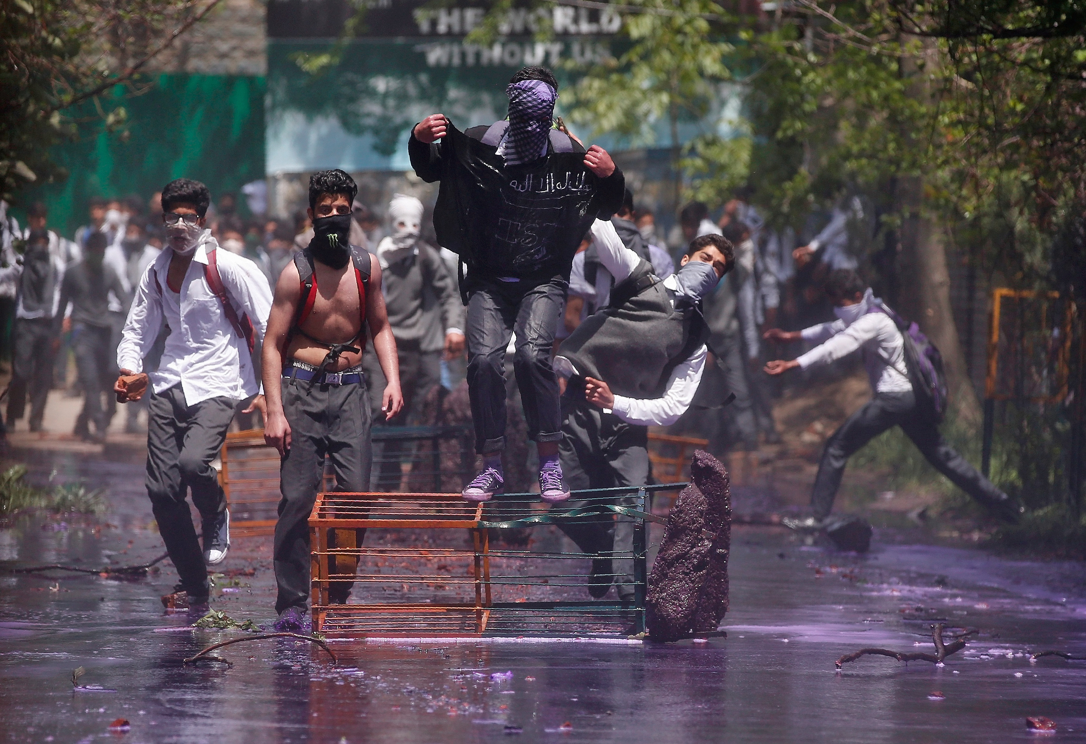 Kashmiri students shout slogans as they throw pieces of bricks and stones towards Indian policemen during a protest in Srinagar April 24, 2017.