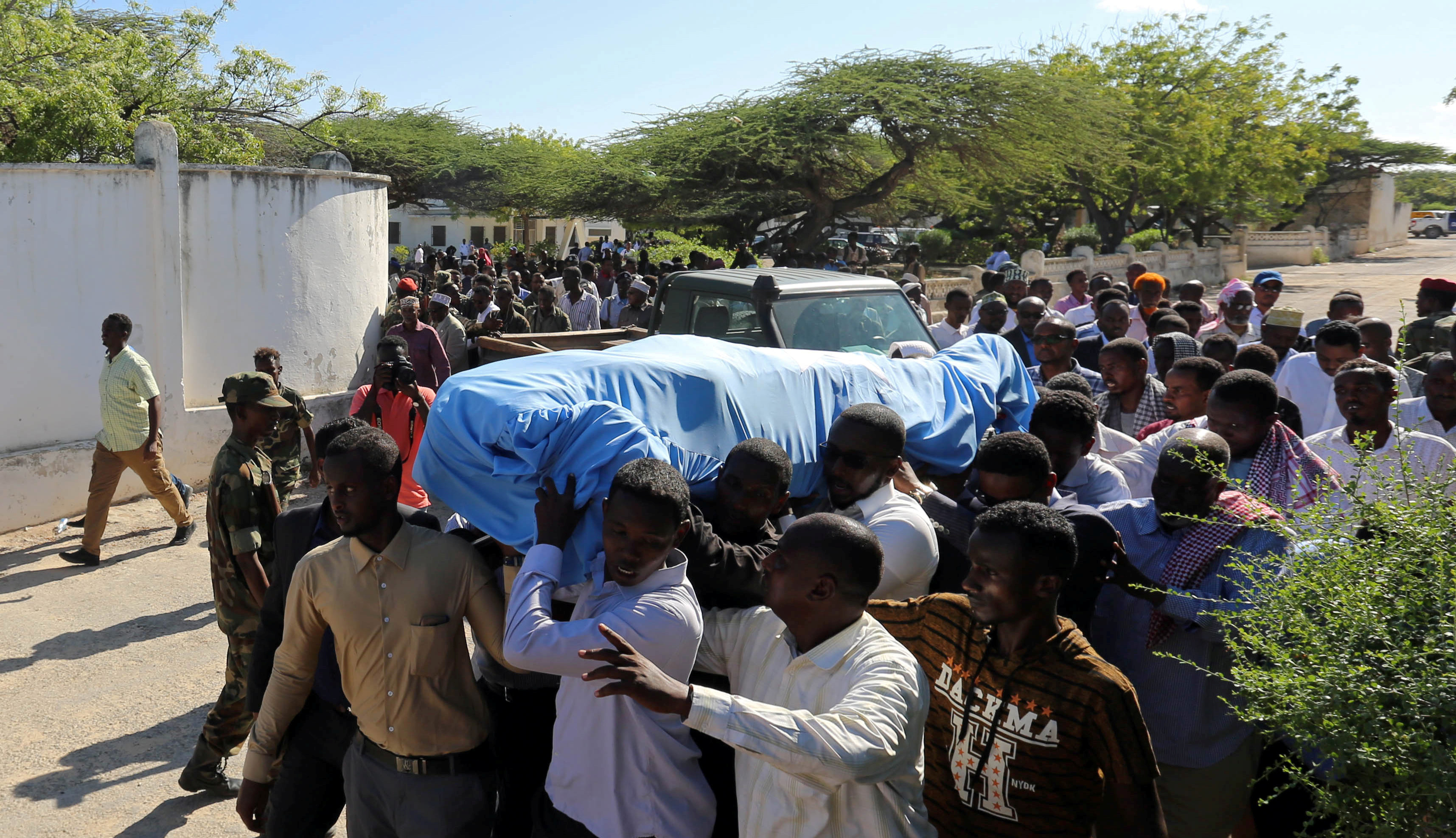 Relatives carry the body of Somalia's public works minister who was shot and killed in the capital Mogadishu, Somalia May 4, 2017.