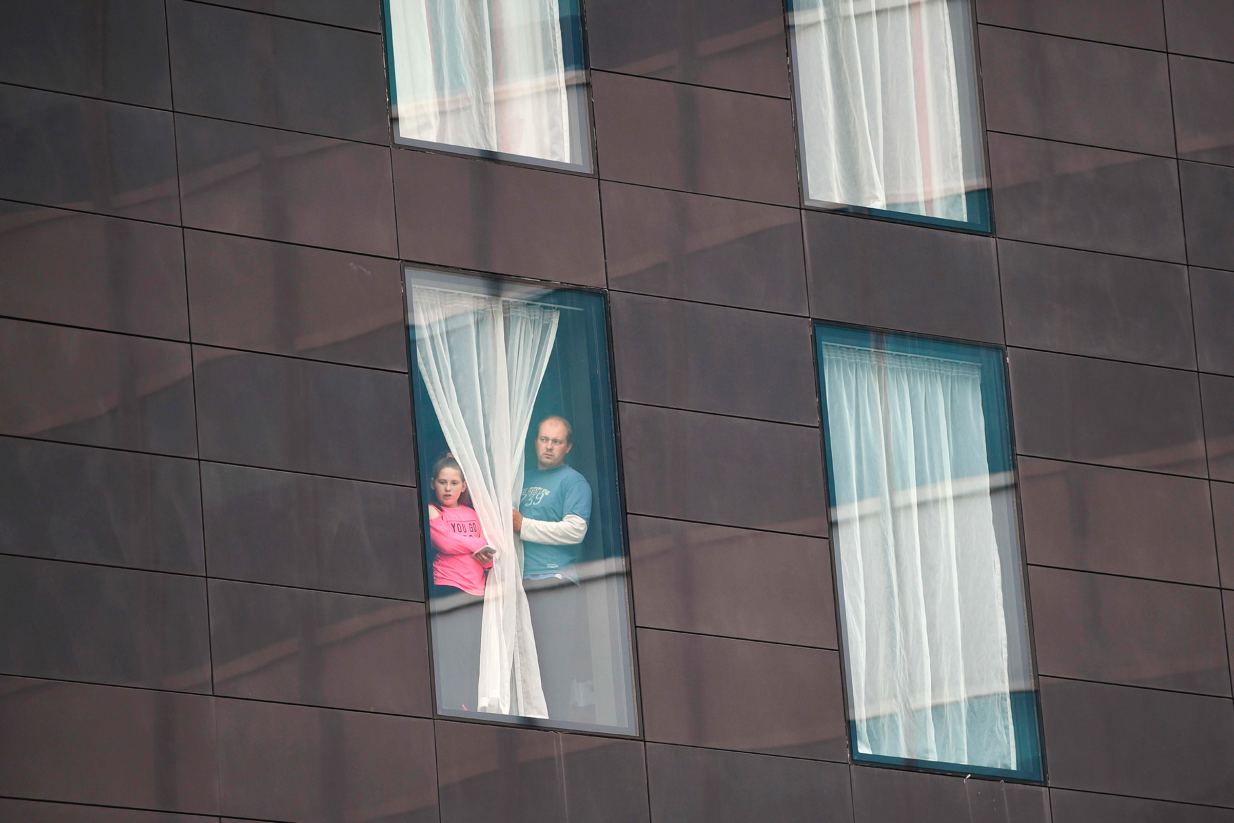 People affected by the May 22 terrorist attack in Manchester looked out from a hotel window