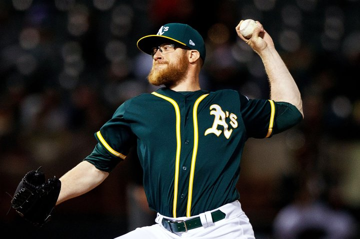 Sean Doolittle of the Oakland Athletics pitches against the Texas Rangers during the seventh inning at the Oakland Coliseum, on April 18, 2017 in Oakland, Calif.