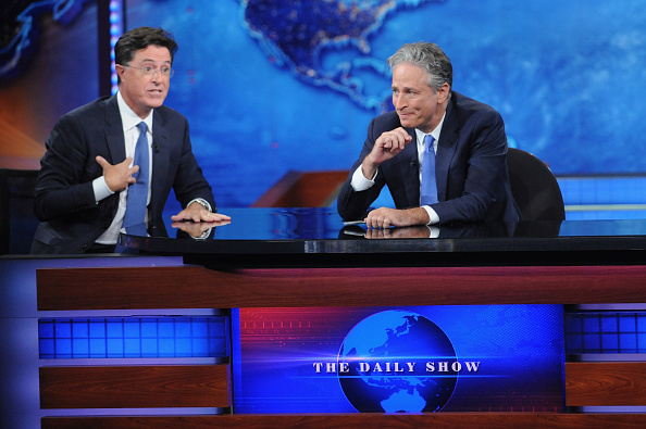 Stephen Colbert and Jon Stewart appear on 'The Daily Show with Jon Stewart' #JonVoyage on August 6, 2015 in New York City.