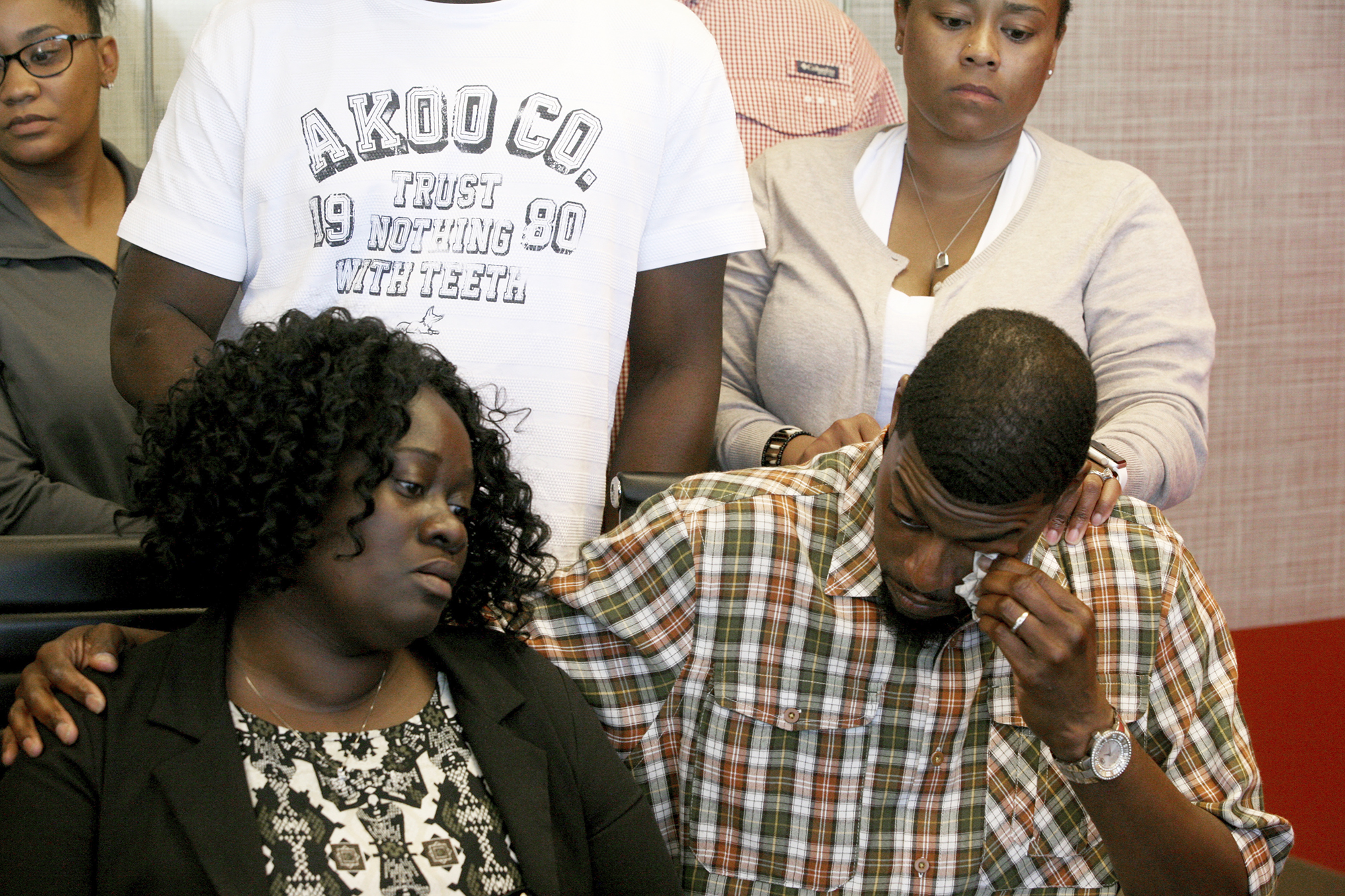 Odell Edwards wipes away tears as he sits with his wife, Charmaine Edwards, listening to their attorney Lee Merritt talking about the death of their son, Jordan Edwards, in a police shooting Saturday in Balch Springs, Texas, in Merritt's law office in Dallas, on May 1, 2017.