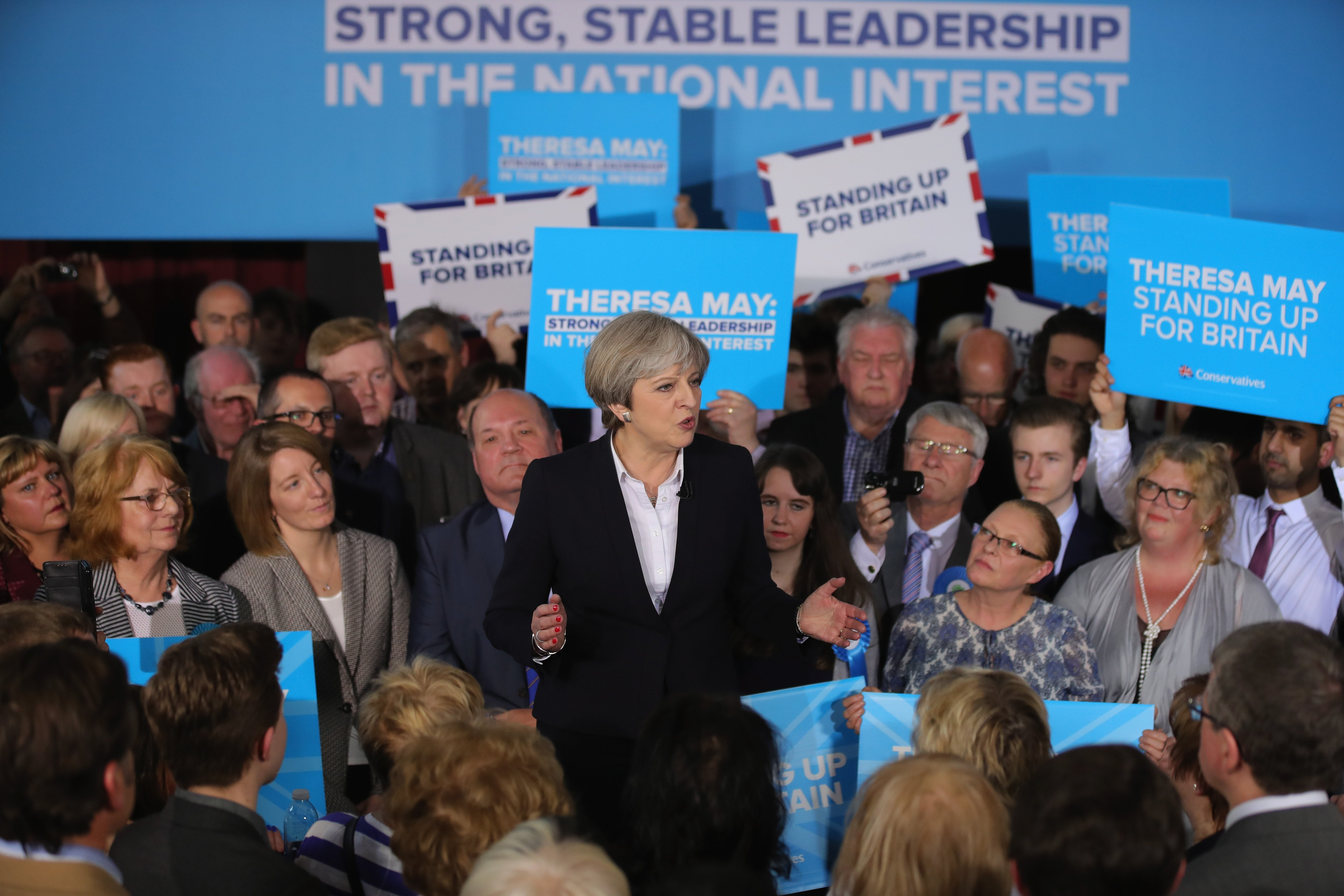 British Prime Minister Theresa May addresses supporters at an election campaign rally on May 1, 2017 in Mawdesley Village Hall near Ormskirk, England.