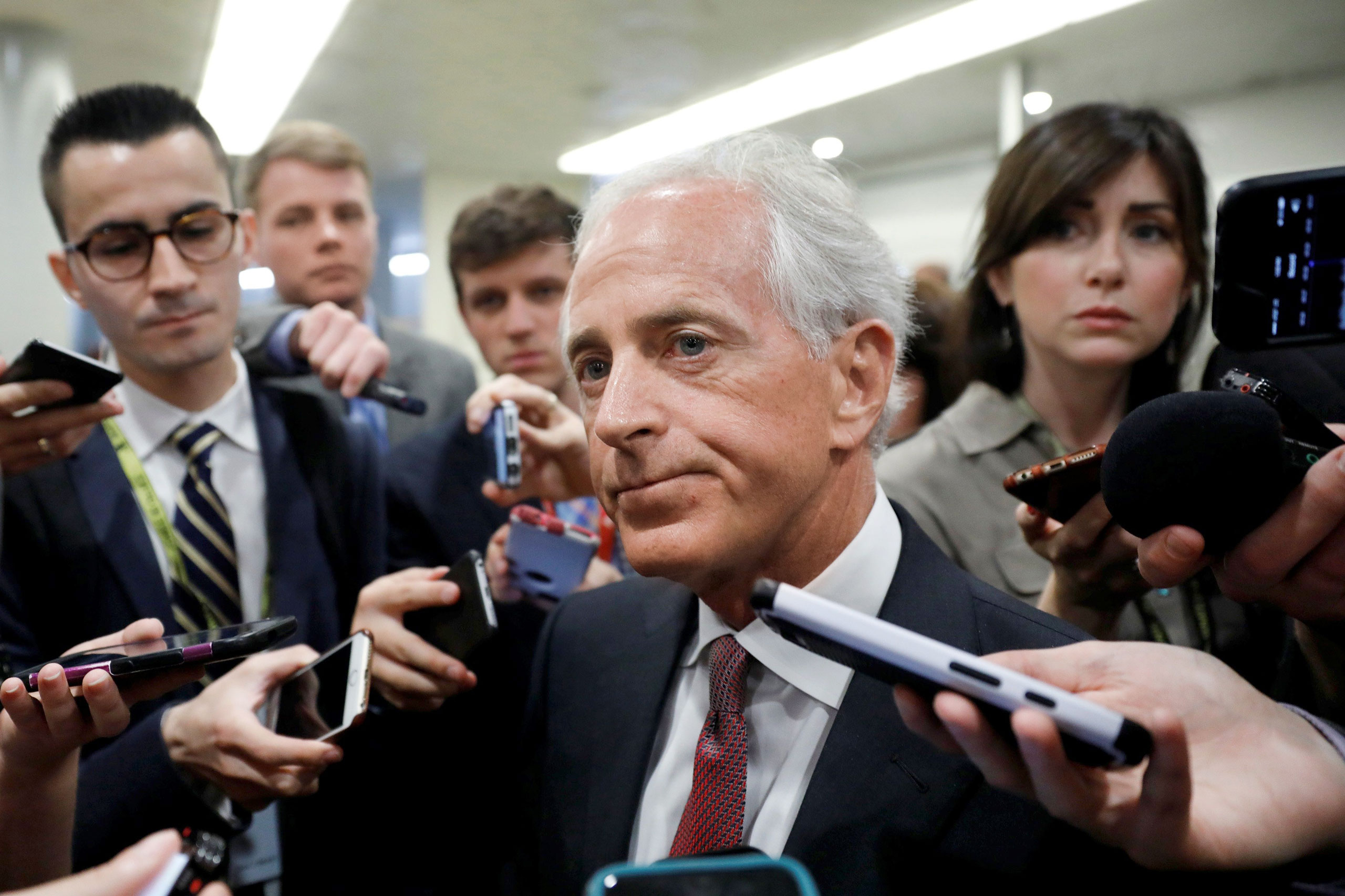 Republican Senator Bob Corker, surrounded by reporters on May 16, sharply criticized a White House in growing disarray