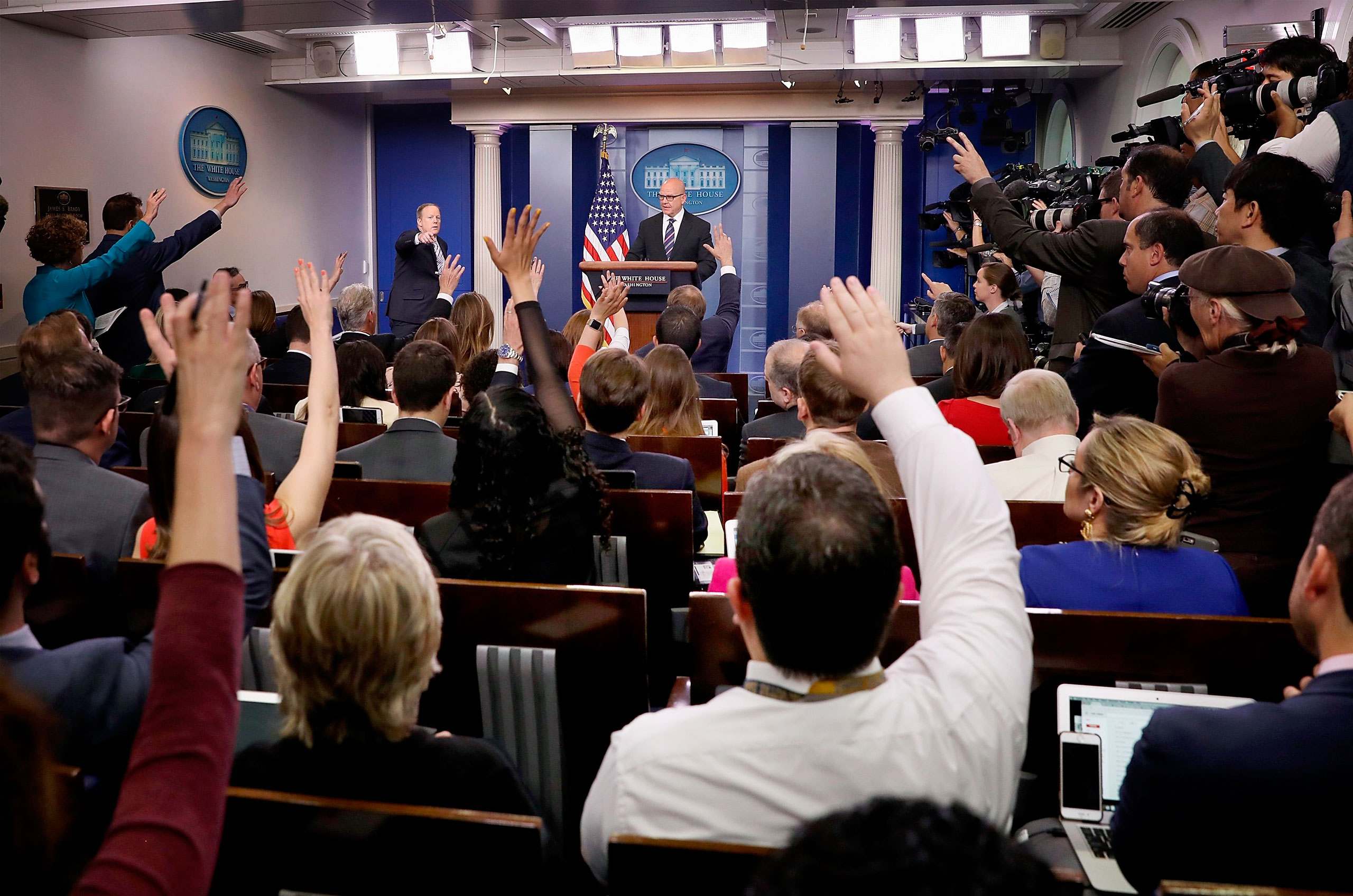 McMaster at the briefing-room podium, defending Trump's decision to share intelligence with Russia