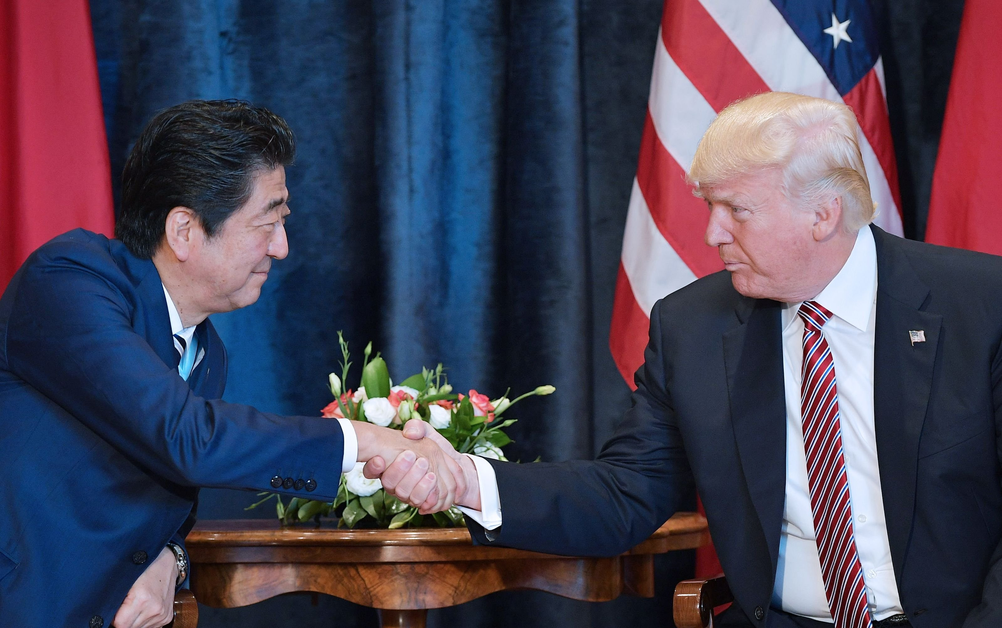 President Donald Trump shakes hands with Japanese Prime Minister Shinzo Abe during a bilateral meeting at the Villa Diodoro on the sidelines of the Summit of the Heads of State and of Government of the G7, the group of most industrialized economies, plus the European Union, on May 26, 2017 in Taormina, Sicily.
