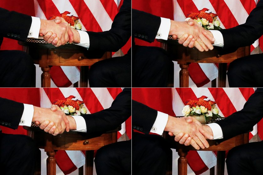 A combination photo shows U.S. President Trump  trying twice to let go of a handshake with France's President Macron as Macron holds tight, before a working lunch ahead of a NATO Summit in Brussels
