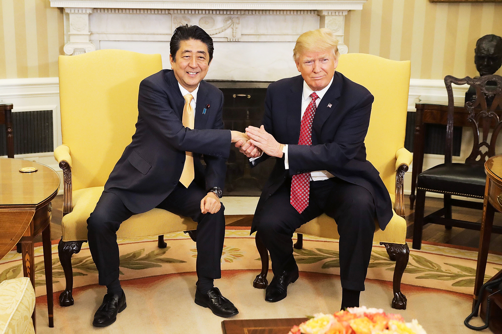 Donald Trump shakes Japanese Prime Minister Shinzo Abe's hand for 19 seconds at the White House in Washington, D.C., on Feb. 10, 2017.