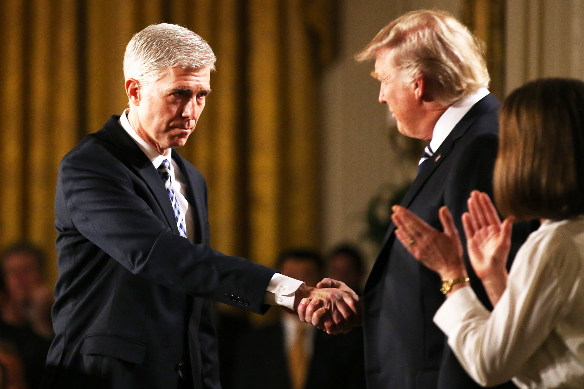 Donald Trump pulls Judge Neil Gorsuch closer to him while shaking hands in Washington, D.C., on Jan. 31, 2017.
