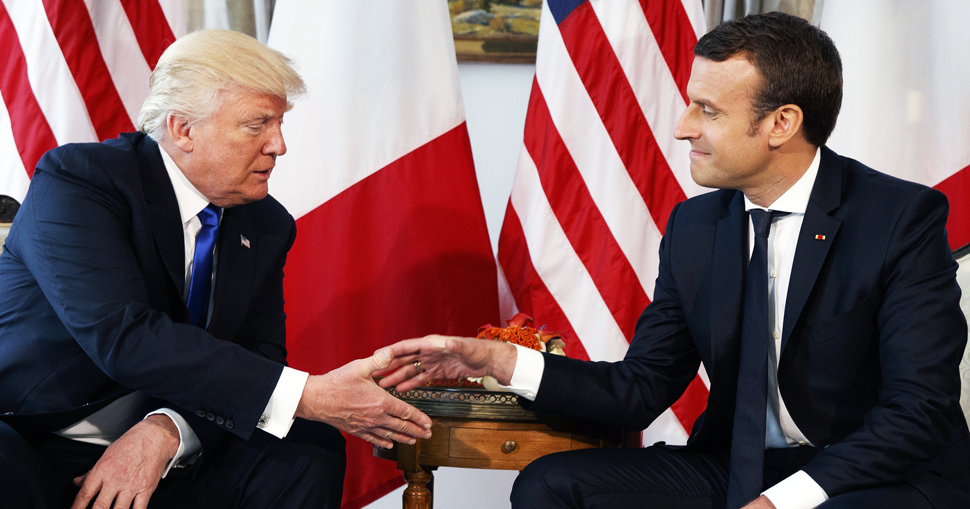 Donald Trump shakes hands with French President Emmanuel Macron during a meeting at the U.S. Embassy, on May 25, 2017, in Brussels.