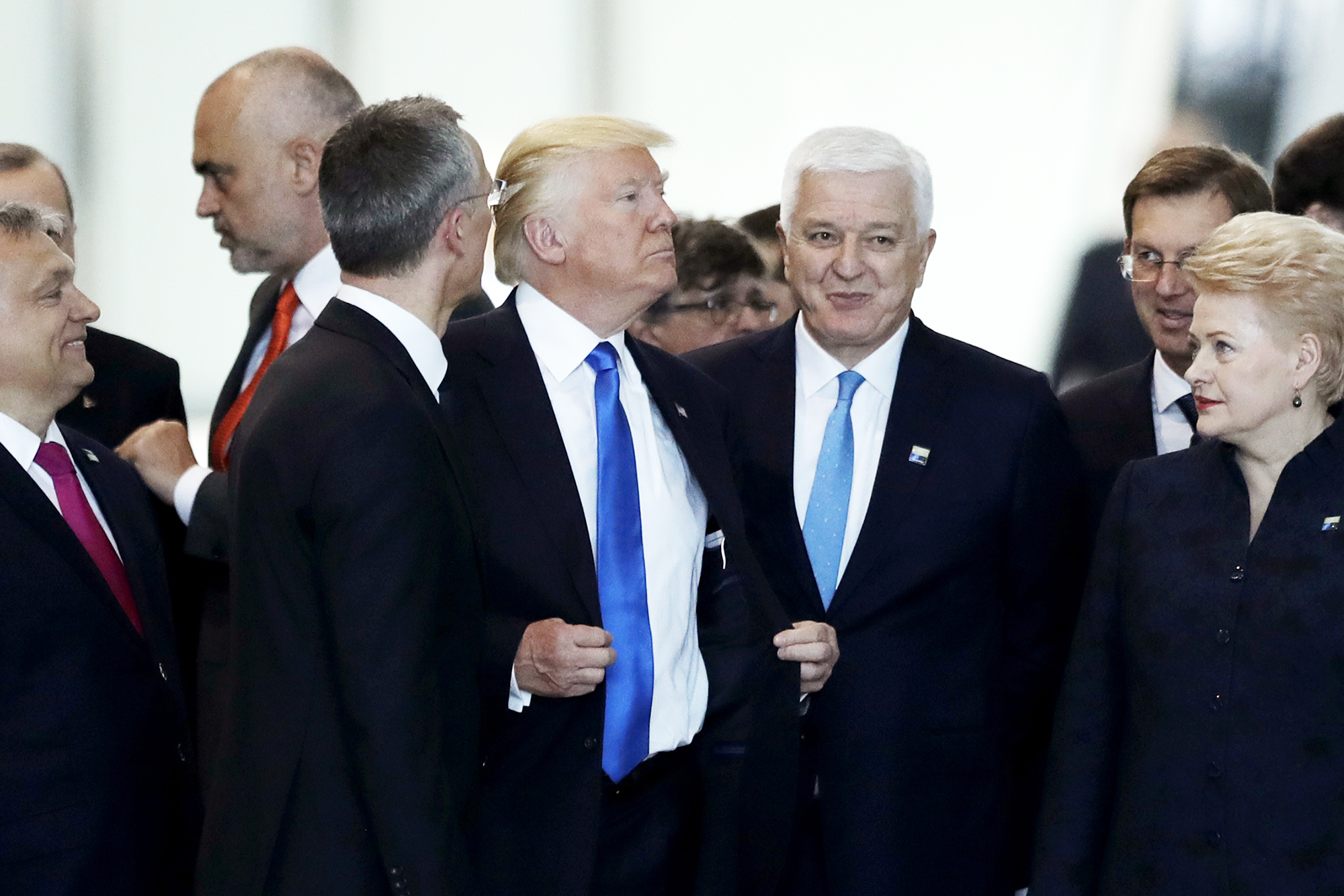 Montenegro Prime Minister Dusko Markovic, center right, after appearing to be pushed by Donald Trump, center, during a NATO summit of heads of state and government in Brussels, on May 25, 2017.