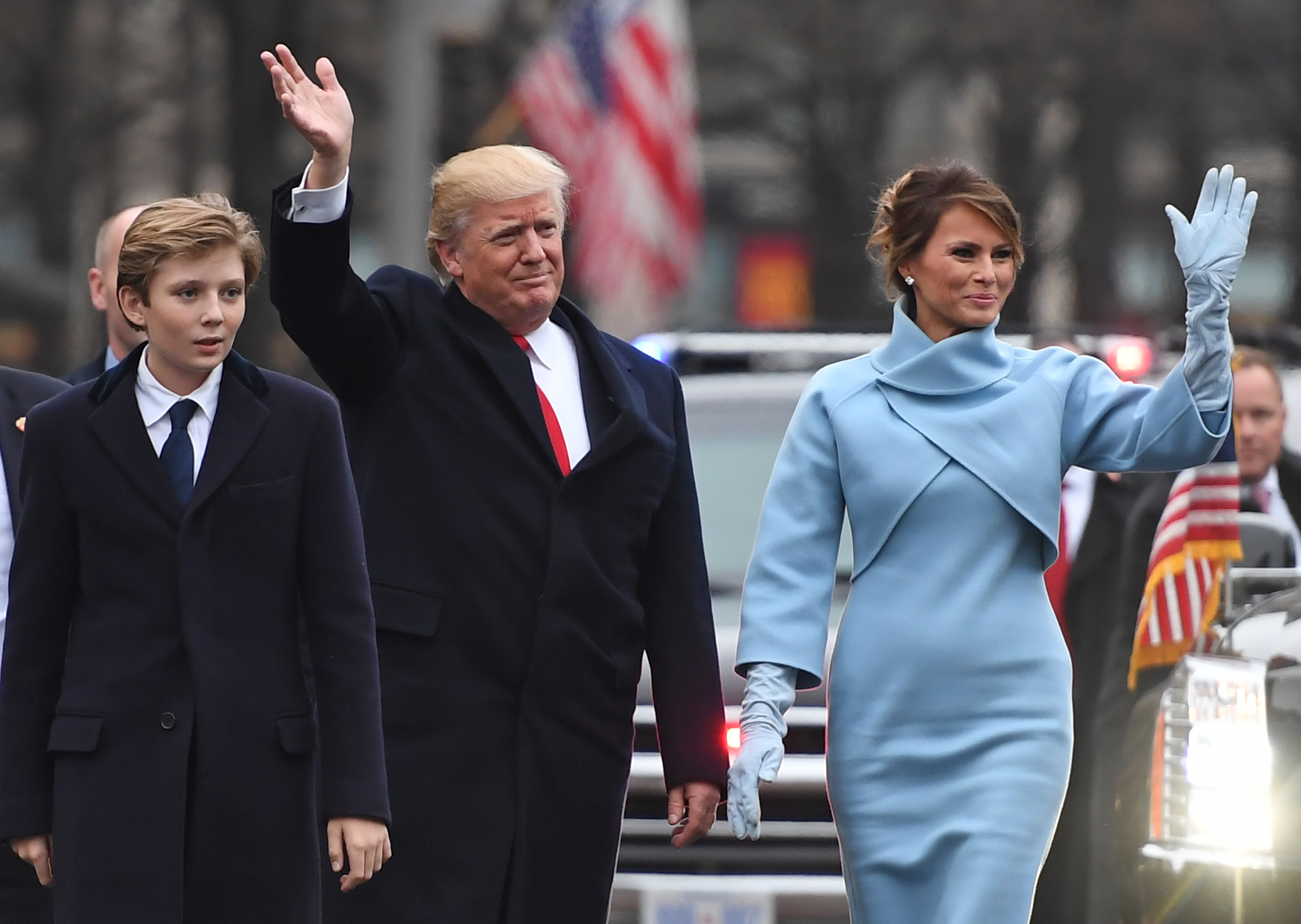 US President Donald Trump and First Lady Melania walk the inaugural parade route with son Barron on Pennsylvania Avenue in Washington, DC, on January 20, 2017 following swearing-in ceremonies on Capitol Hill earlier today.