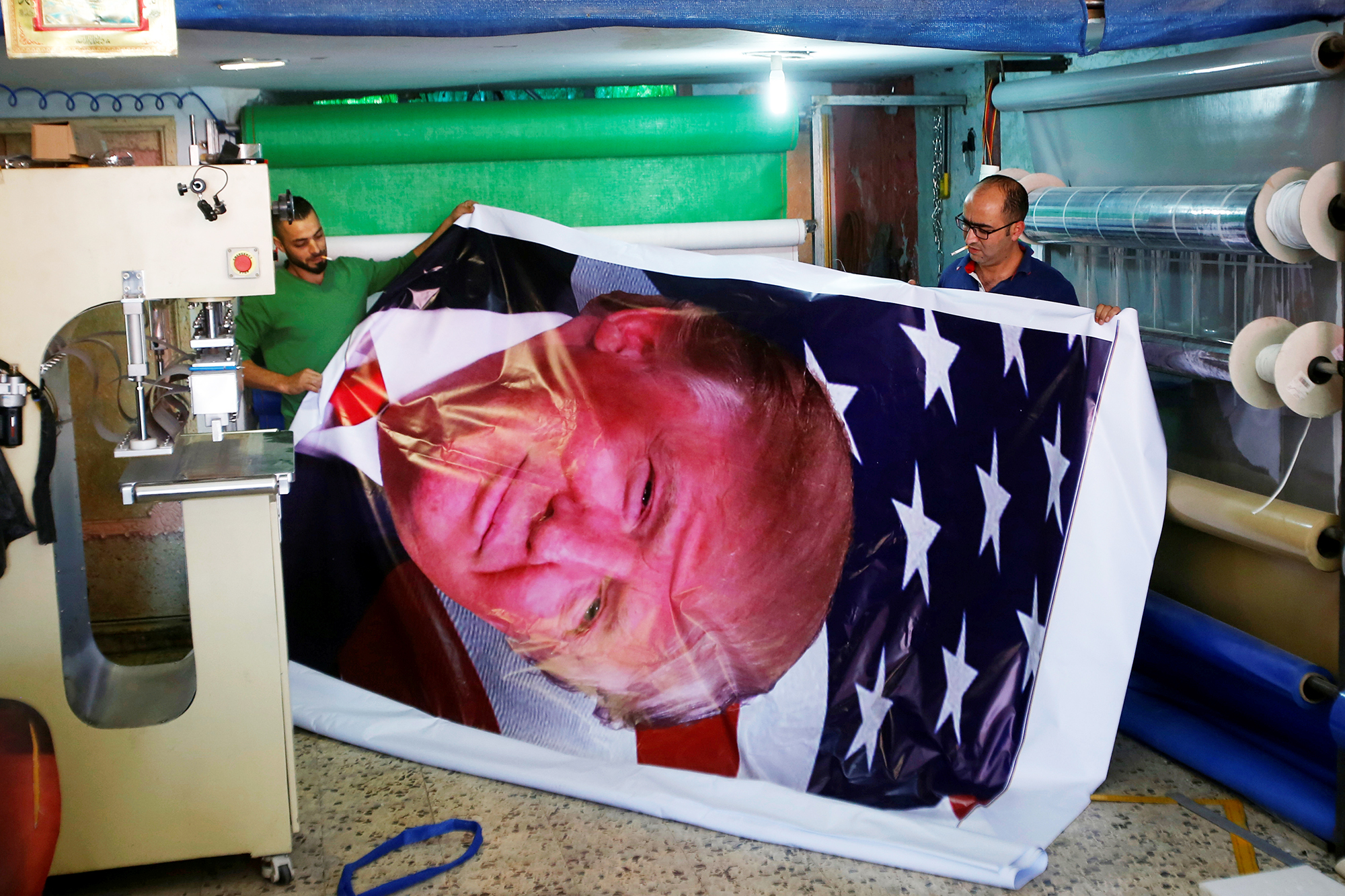 Palestinians print a poster depicting Donald Trump in preparation for his planned visit, in the West Bank town of Bethlehem, on May 21, 2017.