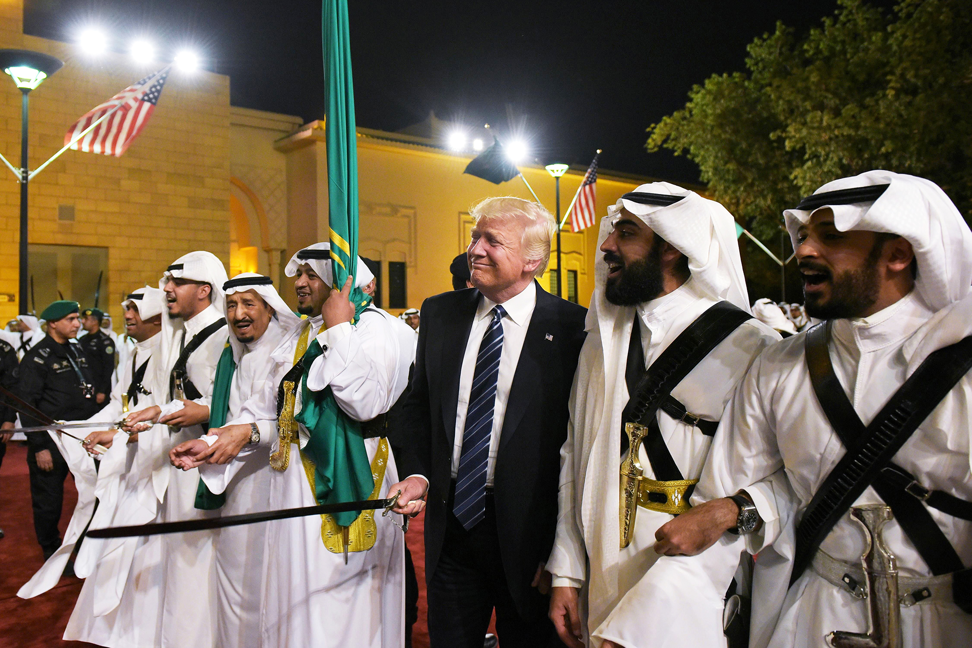 Donald Trump joins dancers with swords at a welcoming ceremony ahead of a banquet at the Murabba Palace in Riyadh, Saudi Arabia, on May 20, 2017.