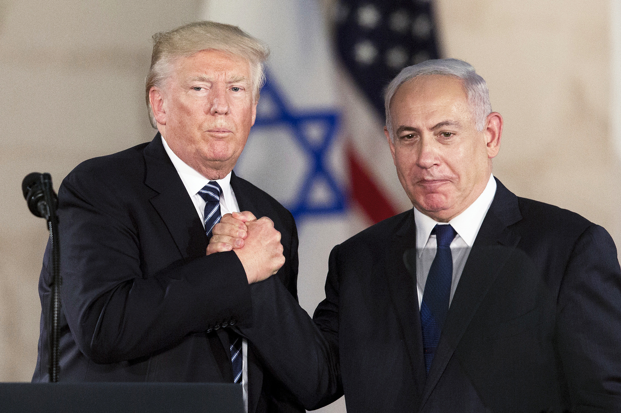 Donald Trump and Israeli Prime Minister Benjamin Netanyahu shake hands at the Israel museum in Jerusalem, on May 23, 2017.