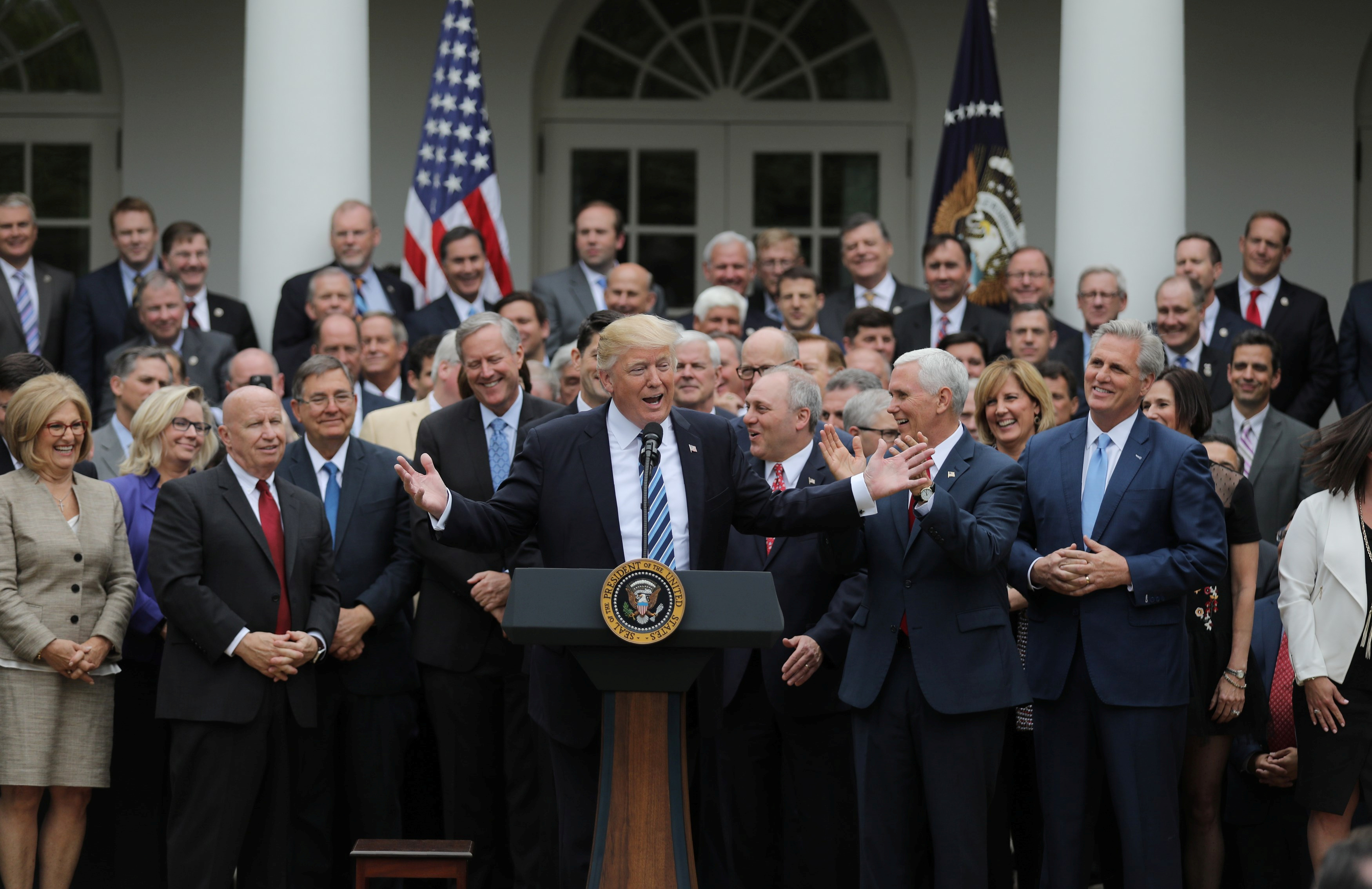President Donald Trump gathers with Congressional Republicans in the Rose Garden of the White House after the House of Representatives approved the American Healthcare Act, to repeal major parts of Obamacare and replace it with the Republican healthcare plan, in Washington, May 4, 2017.