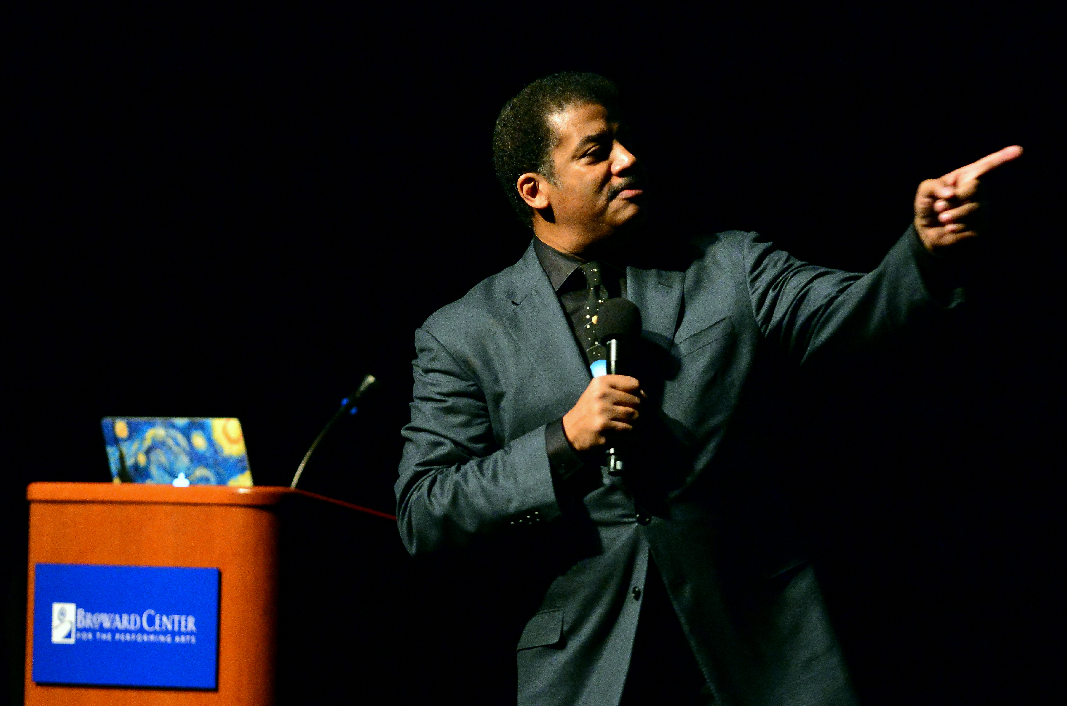 Pointing the way: Tyson at a 2016 talk in Ft. Lauderdale