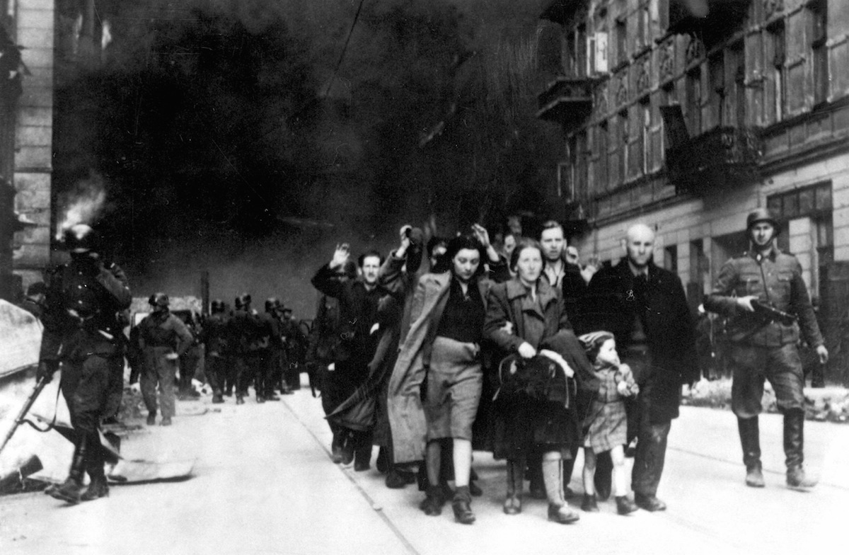 Jewish people being led for deportation in the Warsaw Ghetto, during the Warsaw Ghetto Uprising in 1943.