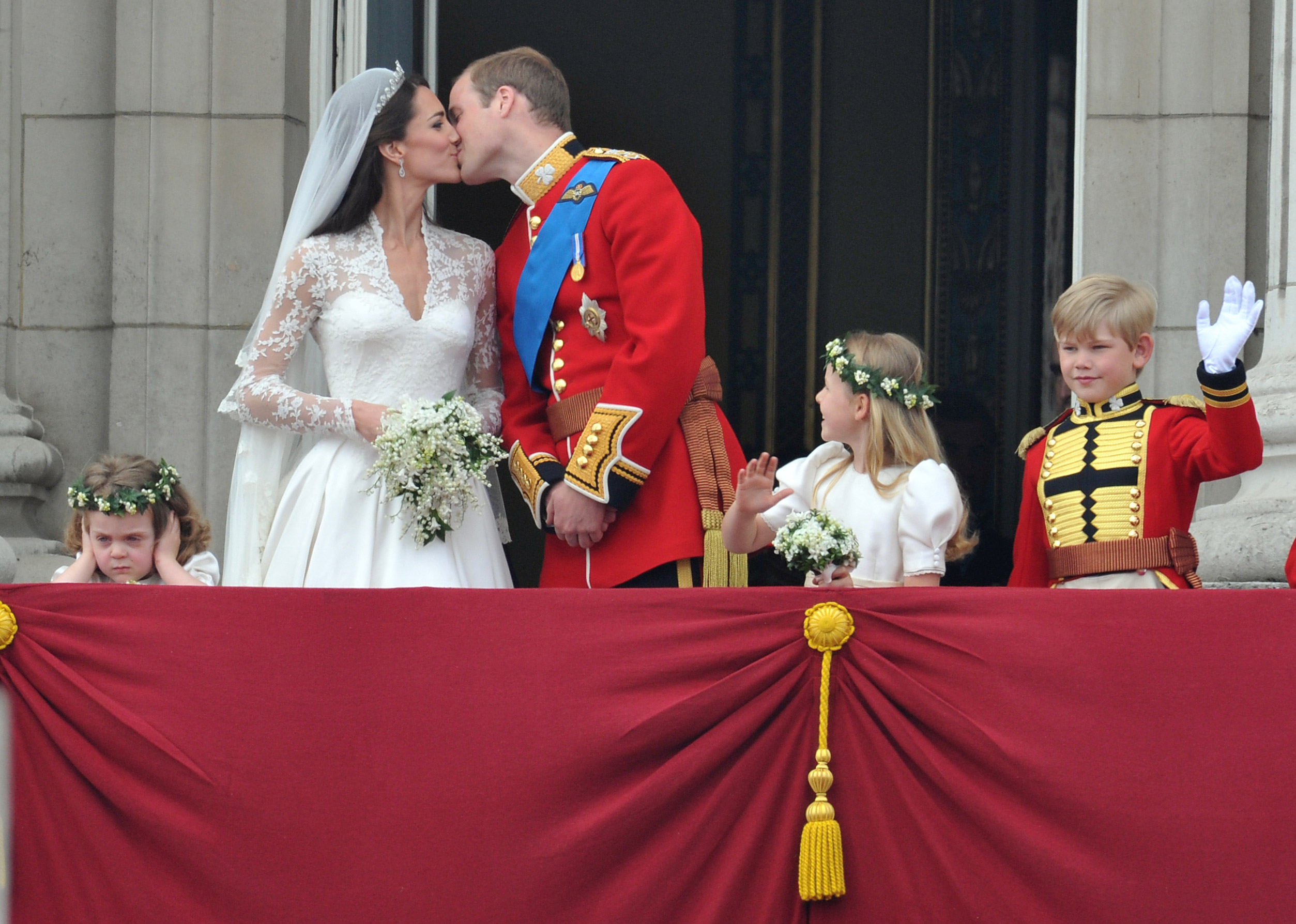 Princess Catherine and Prince William—with attendants—on the balcony of Buckingham Palace in London, Britain, April 29, 2011, after their marriage ceremony.