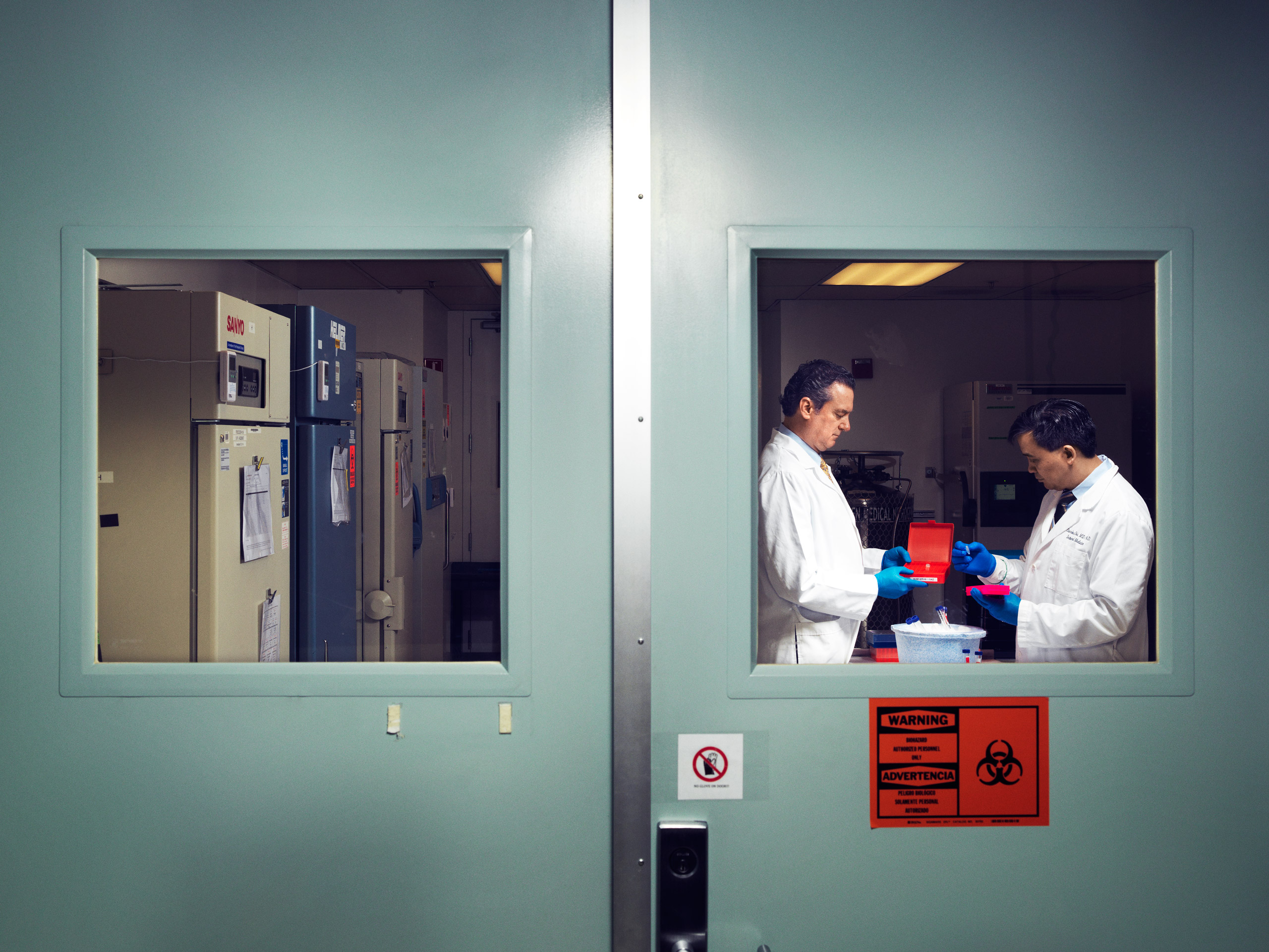 John Hackett and Charles Chiu handle Zika samples at the University of California, San Francisco-Abbott Viral Diagnostics and Discovery Center Cody Pickens for TIME