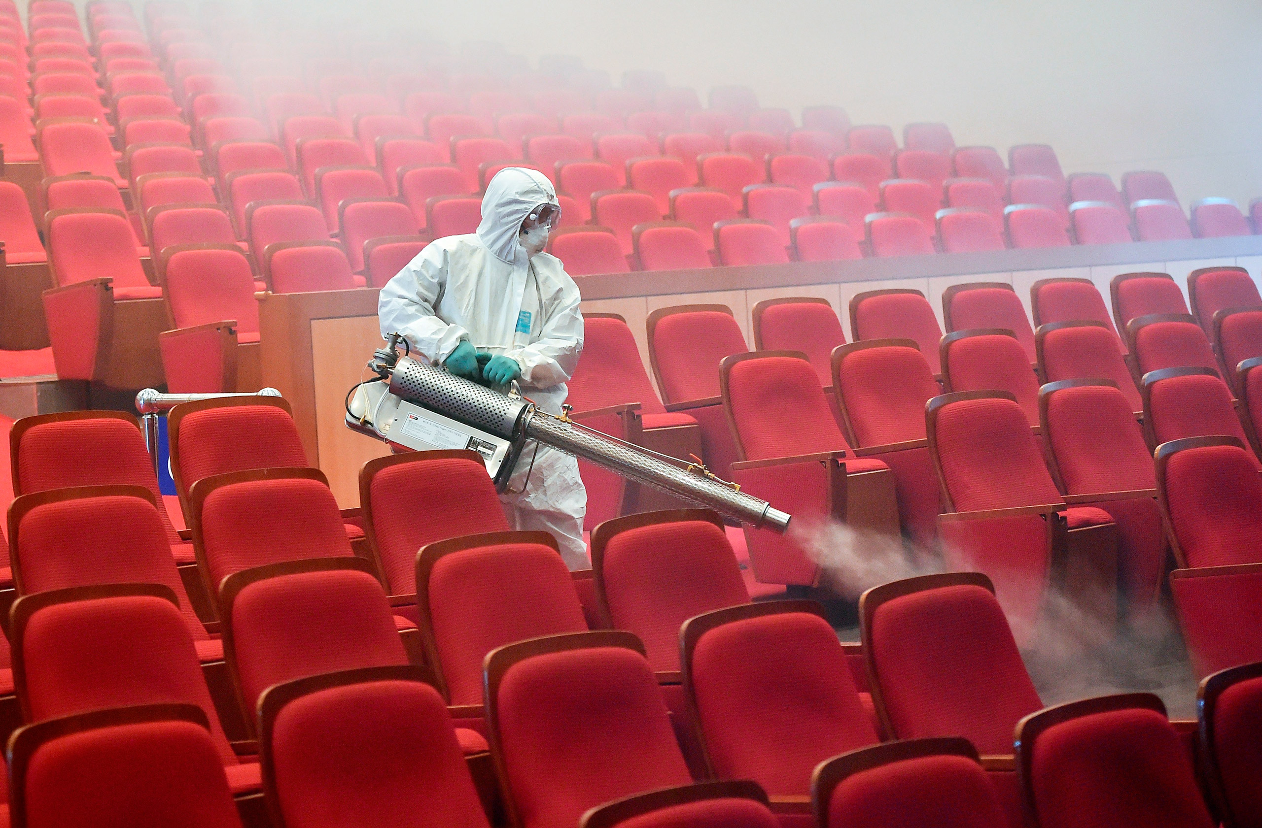 A South Korean health worker fumigates a movie theater in June 2015 after MERS cases were reported