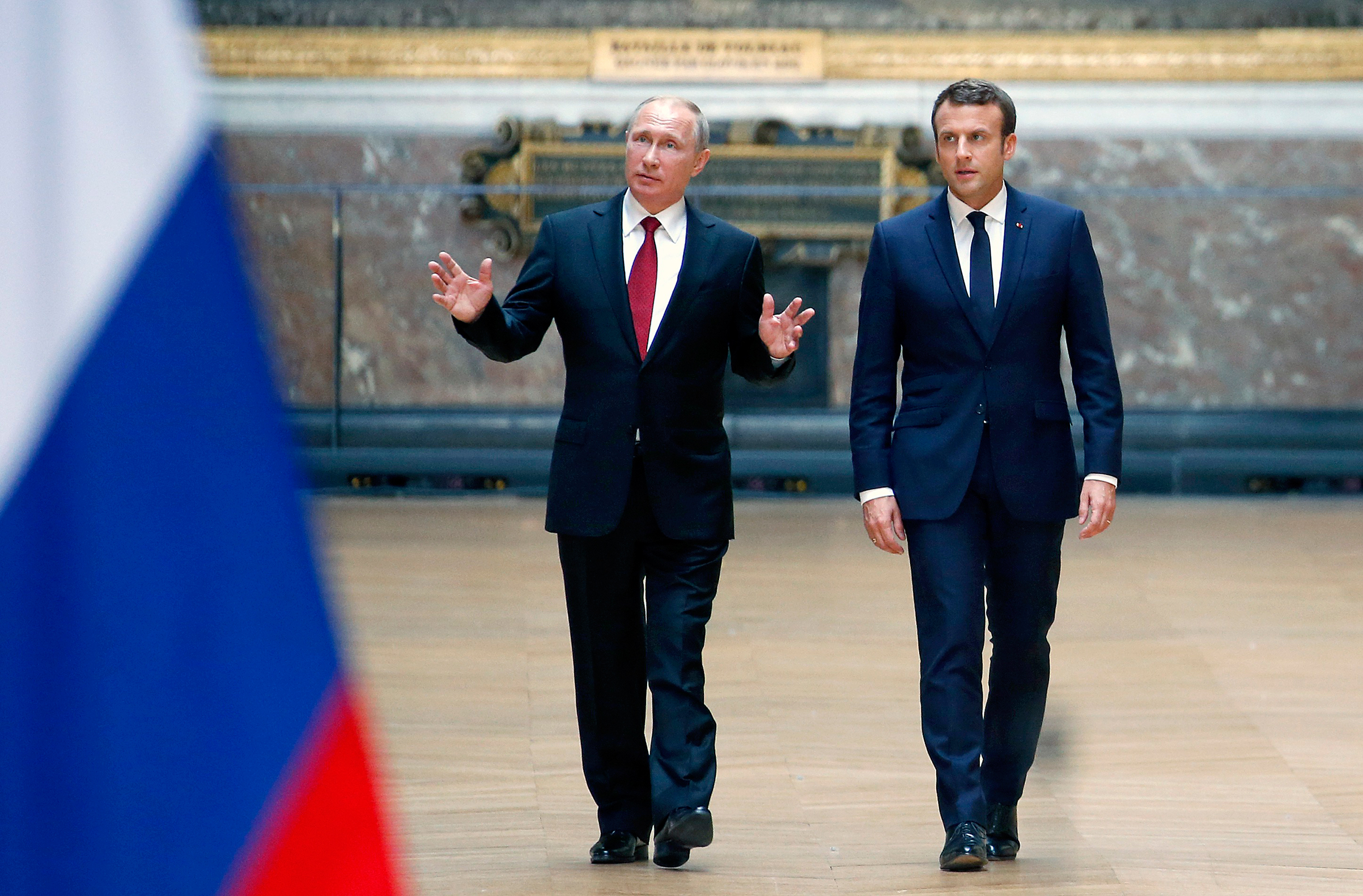 Macron (right) raised concerns with Putin about gay rights in Chechnya