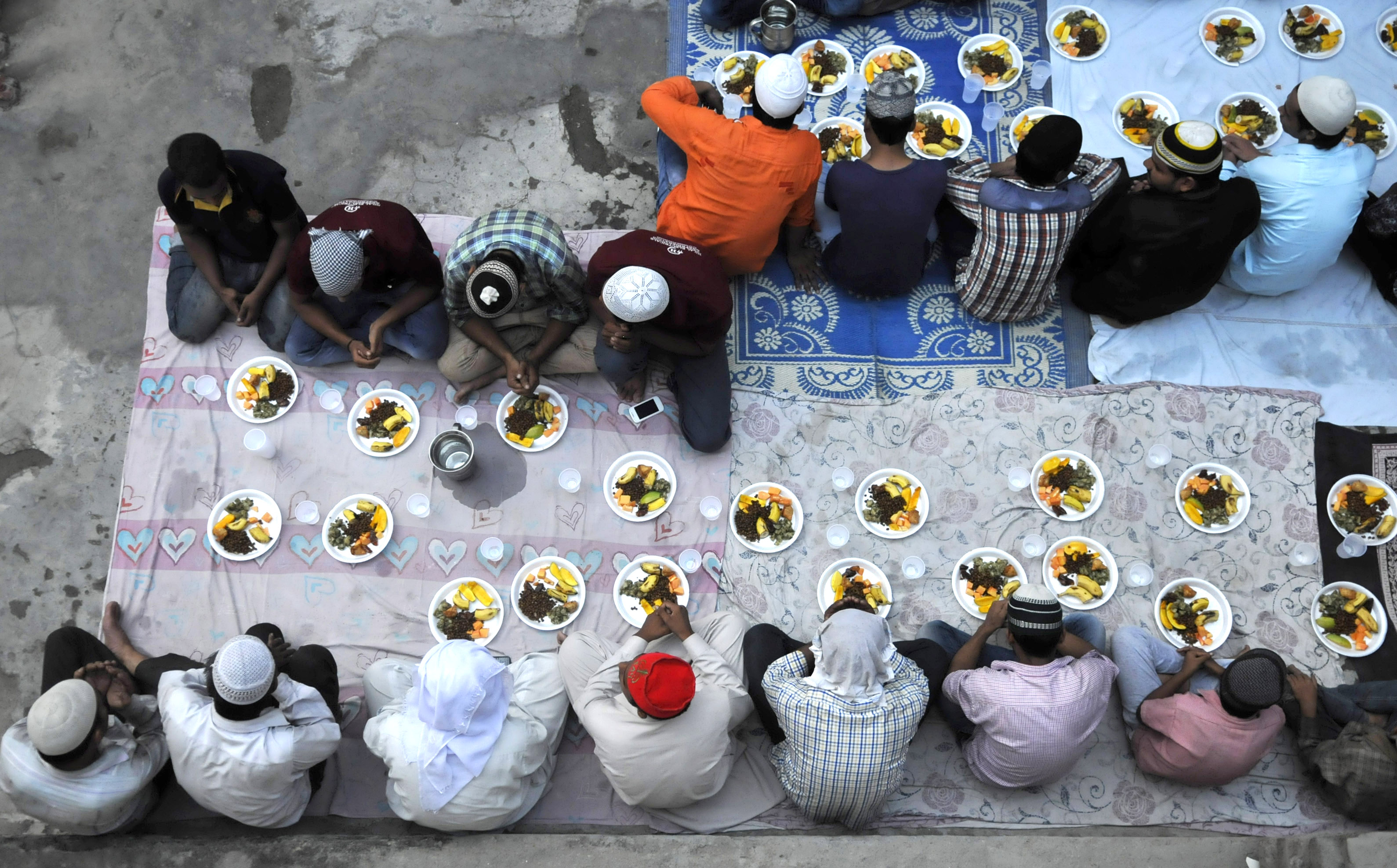 Muslims offer prayers before breaking their Roza fast with Iftar meal during the ongoing month of Ramzan on June 28, 2016 in Noida, India.