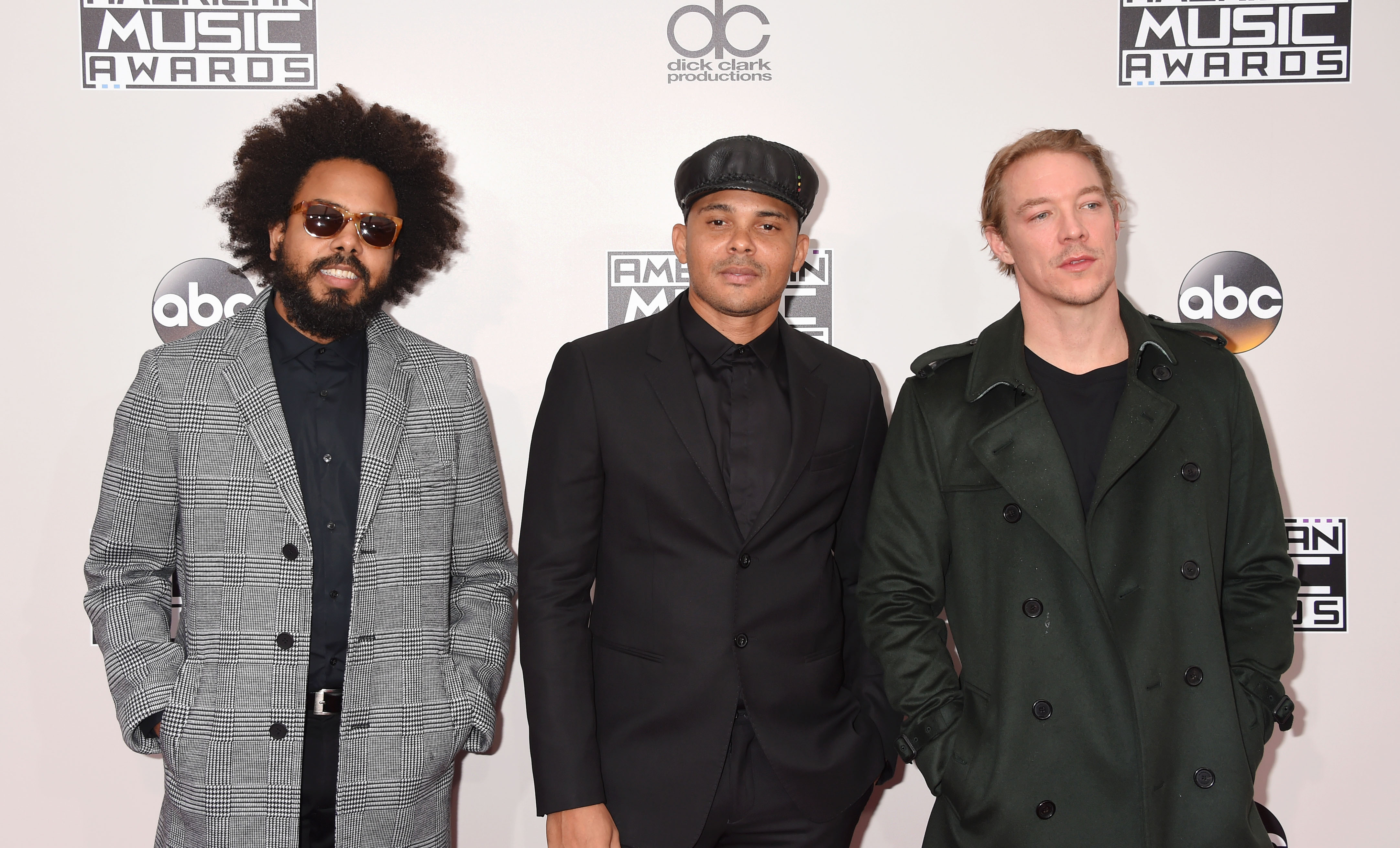 (L-R) Jillionaire, Walshy Fire and Diplo of Major Lazer arrive at the 2016 American Music Awards at Microsoft Theater on November 20, 2016 in Los Angeles, California.