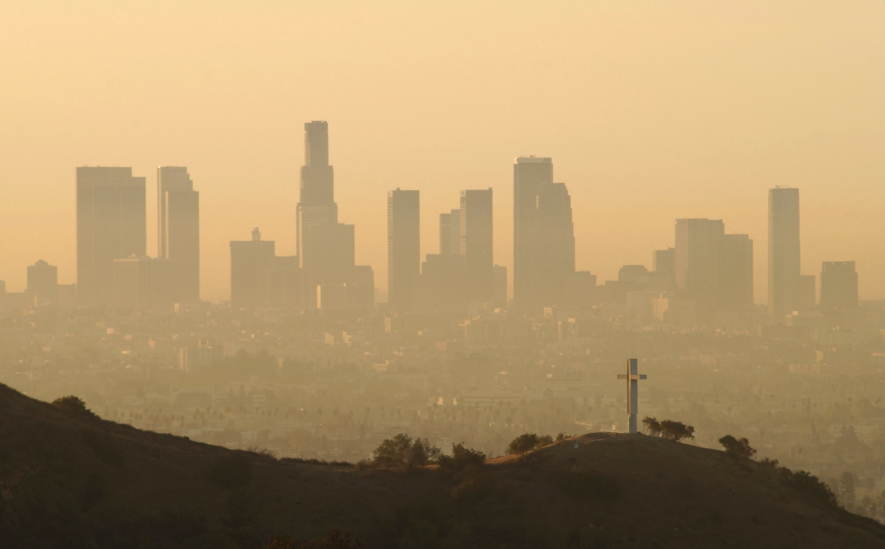 Downtown highrise buildings are shown cloaked in dirty air shortly after sunrise September 11, 2002 in Los Angeles.