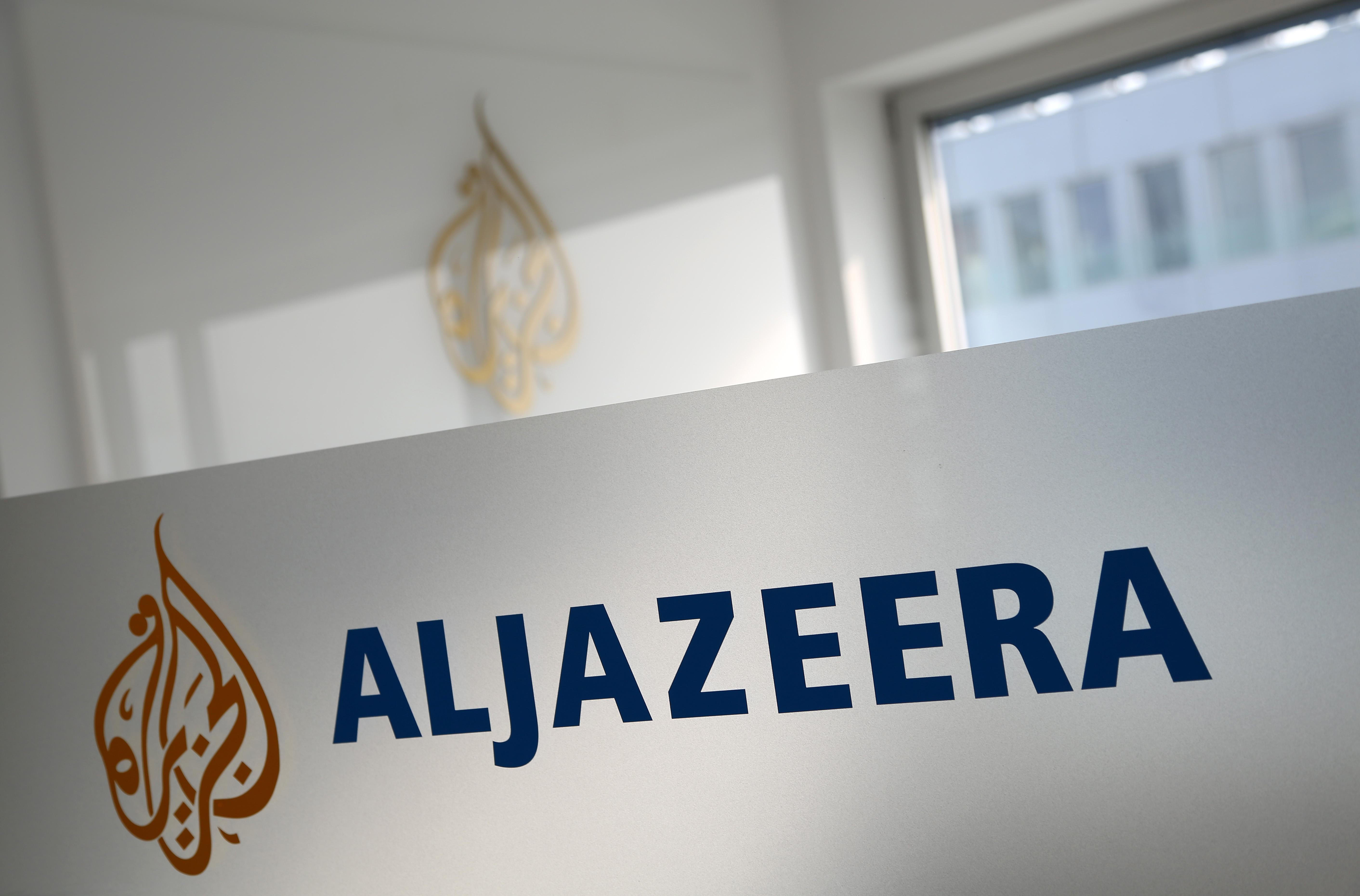 A logo is seen at the Al Jazeera bureau in Berlin.
